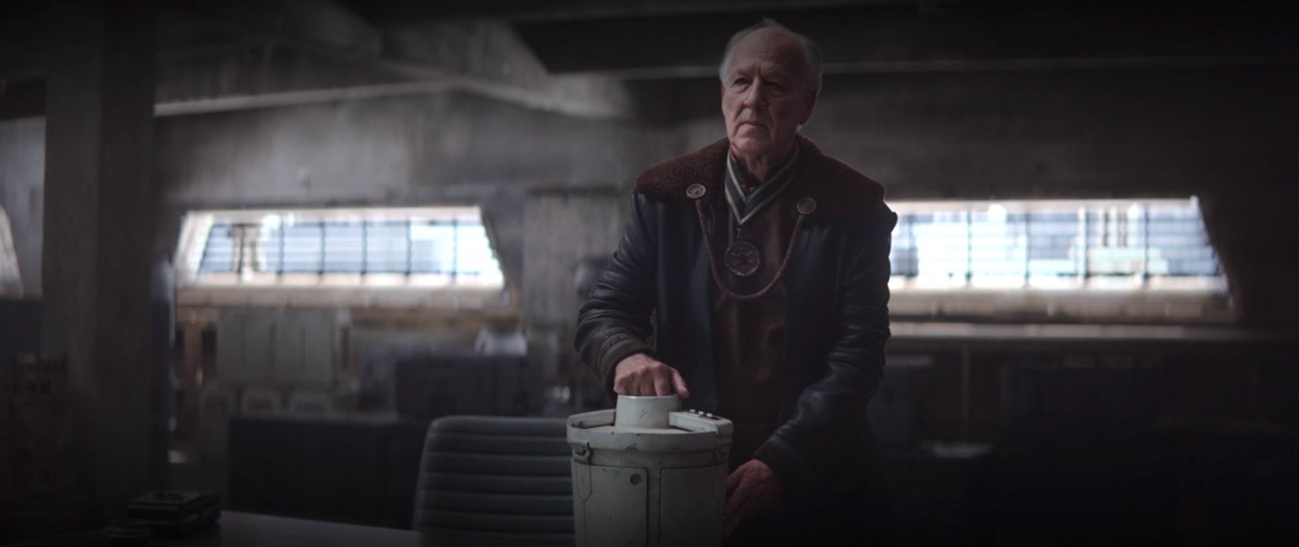 the client holds a camtono aka an ice cream maker on a table in star wars: the mandalorian