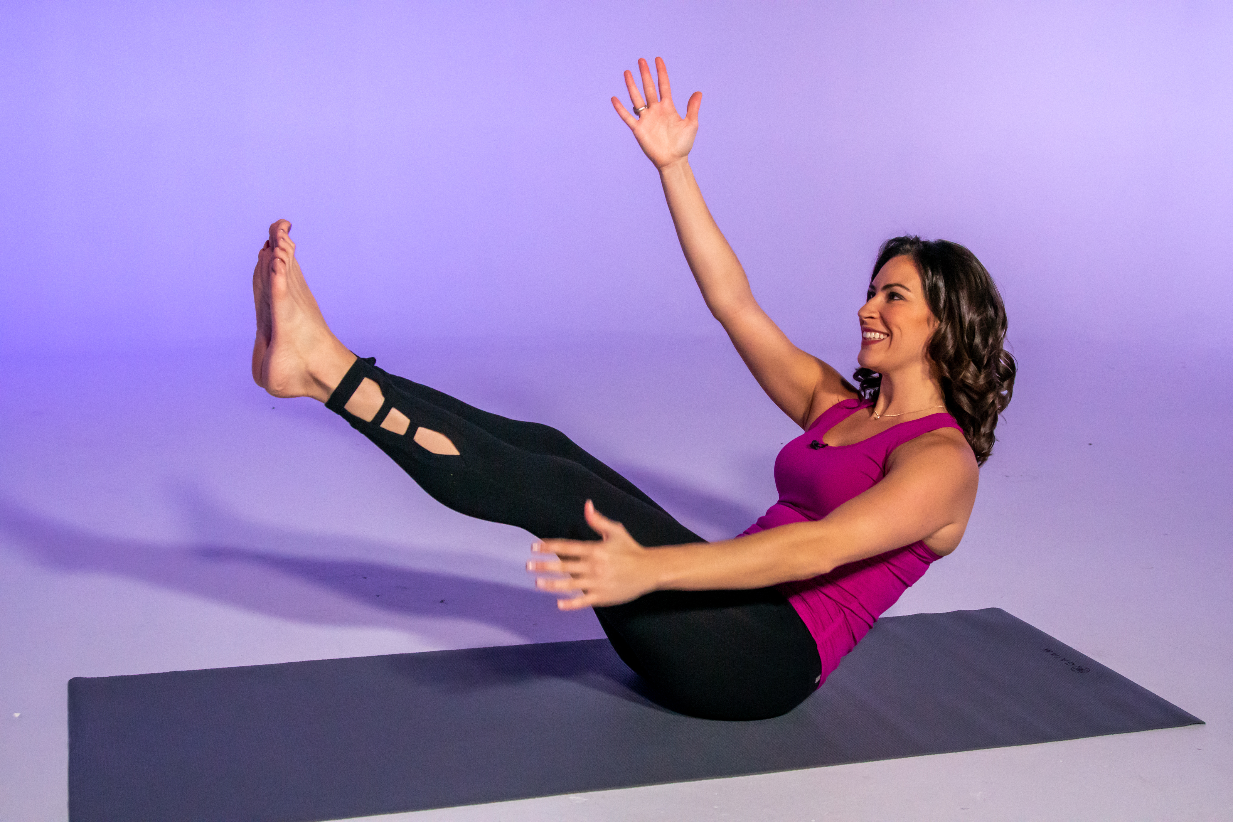 Health and fitness expert Stephanie Mansour demonstrates a modified V-sit that is part of her improving-your-balance workout.