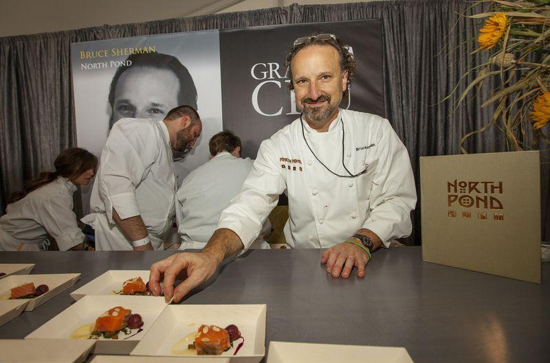 A white male chef in a chef's coat.
