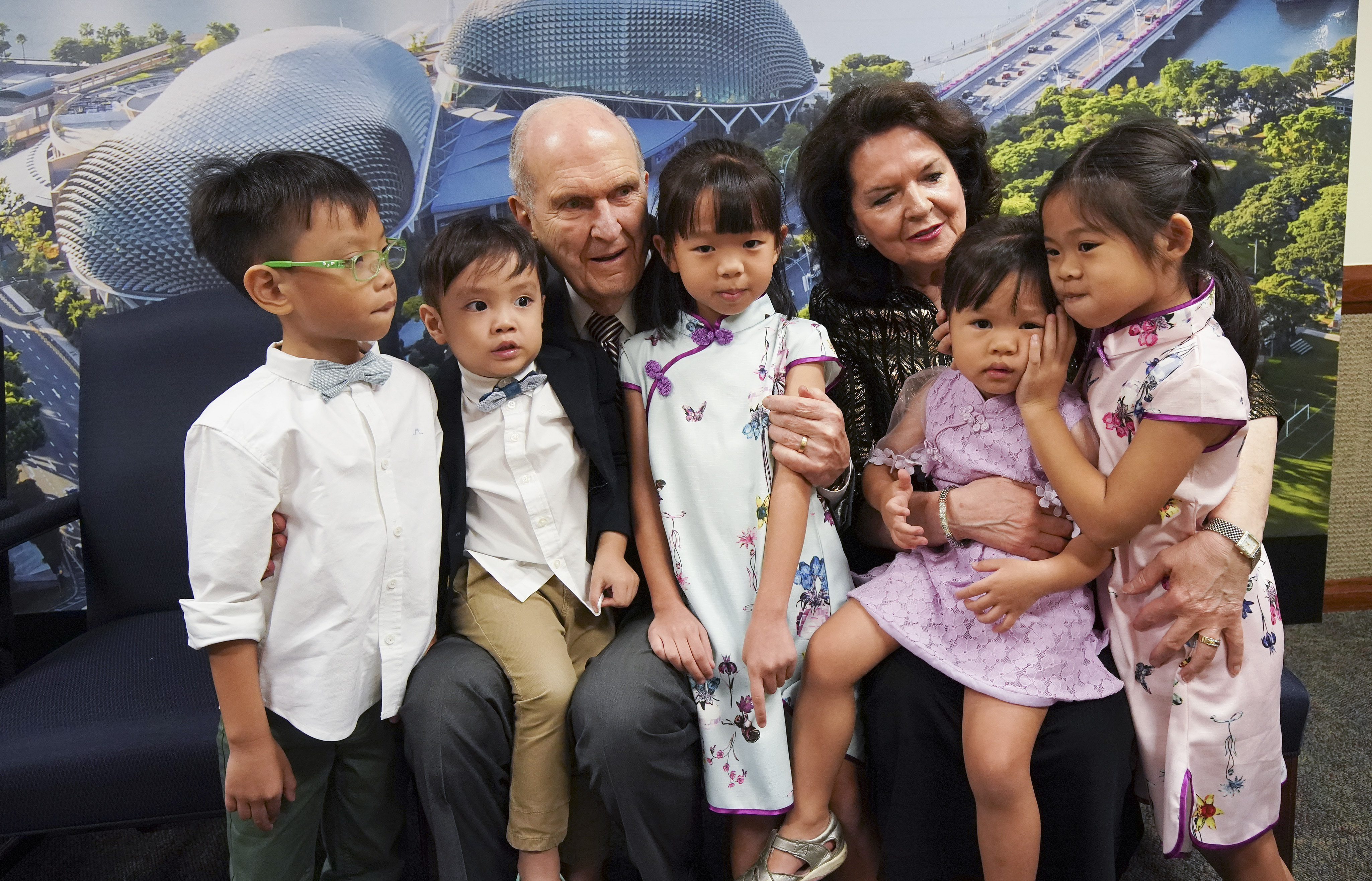 President Russell M. Nelson of The Church of Jesus Christ of Latter-day Saints and his wife, Sister Wendy Nelson, talks with children while meeting with a three-generation family in Singapore on Nov. 20, 2019.