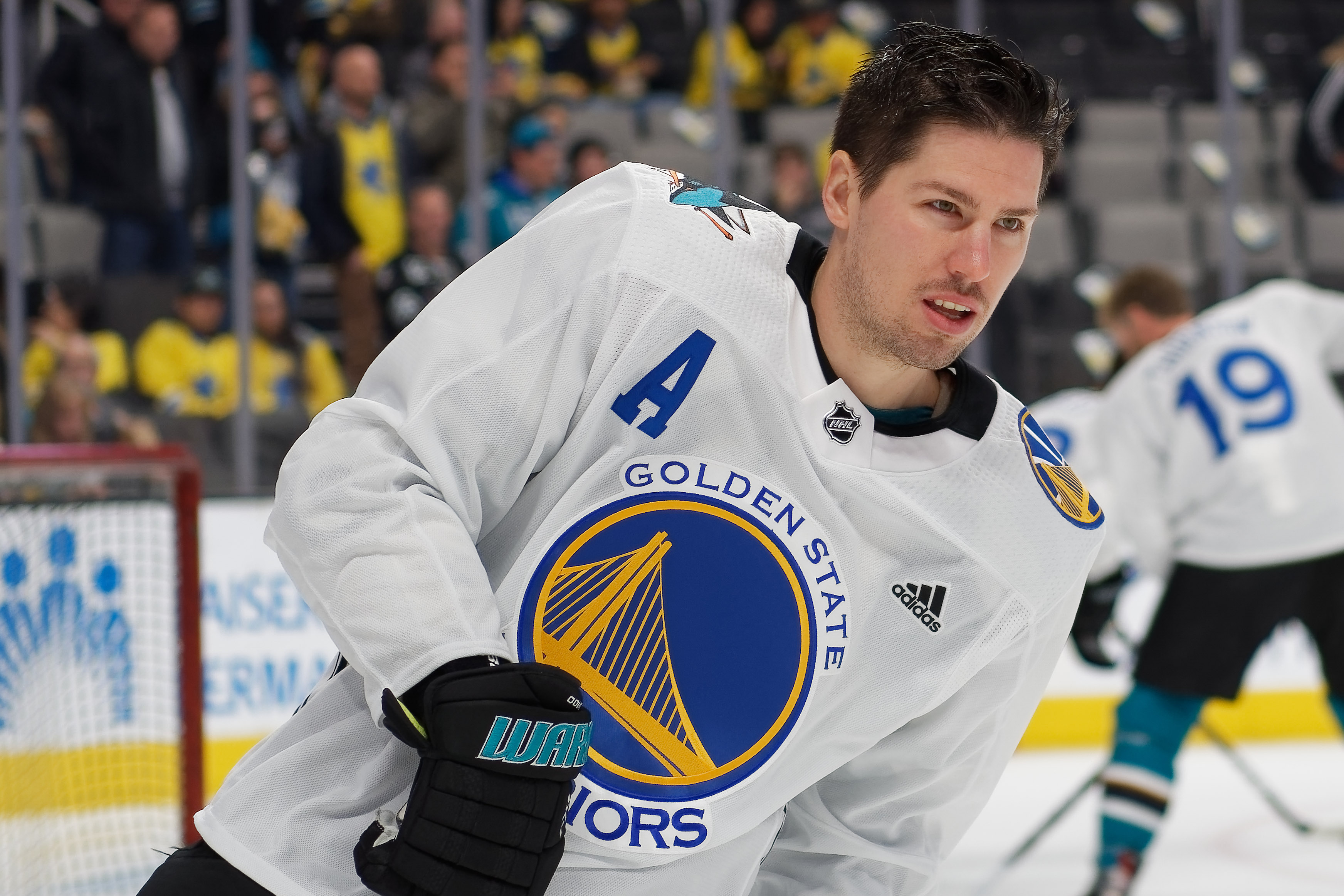 Feb 16, 2019; San Jose, CA, USA; San Jose Sharks center Logan Couture (39) skates in a Golden State Warriors jersey prior to a game against the Vancouver Canucks at SAP Center at San Jose.