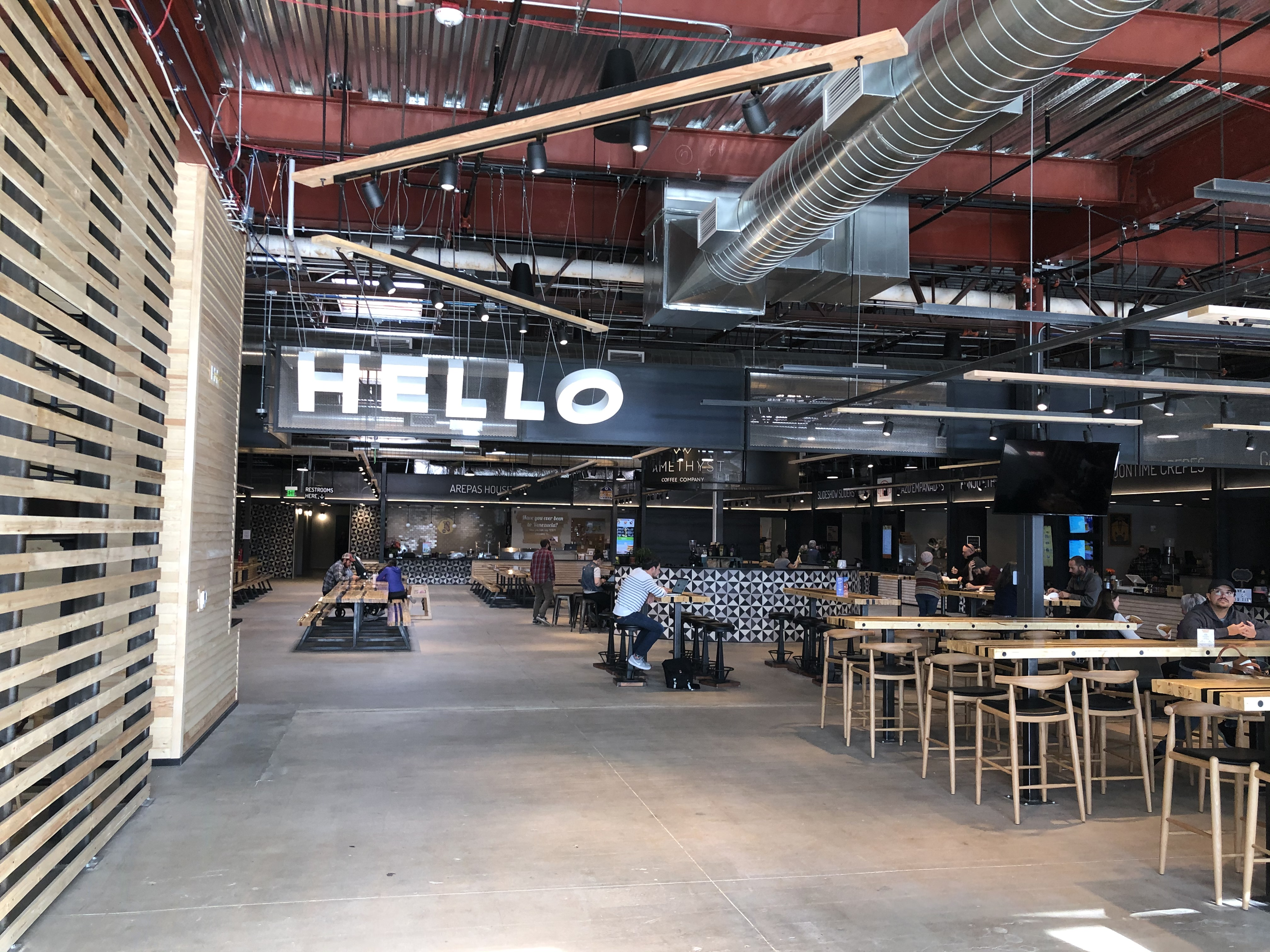 Look Inside Edgewater's New Mural-Filled Food Hall With an Industrial Feel