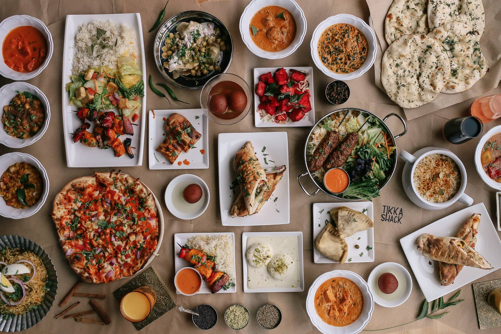 A tabled filed with curries, breads, rice dishes and samosas from the Tikka Shack menu, on its way to Town Square.