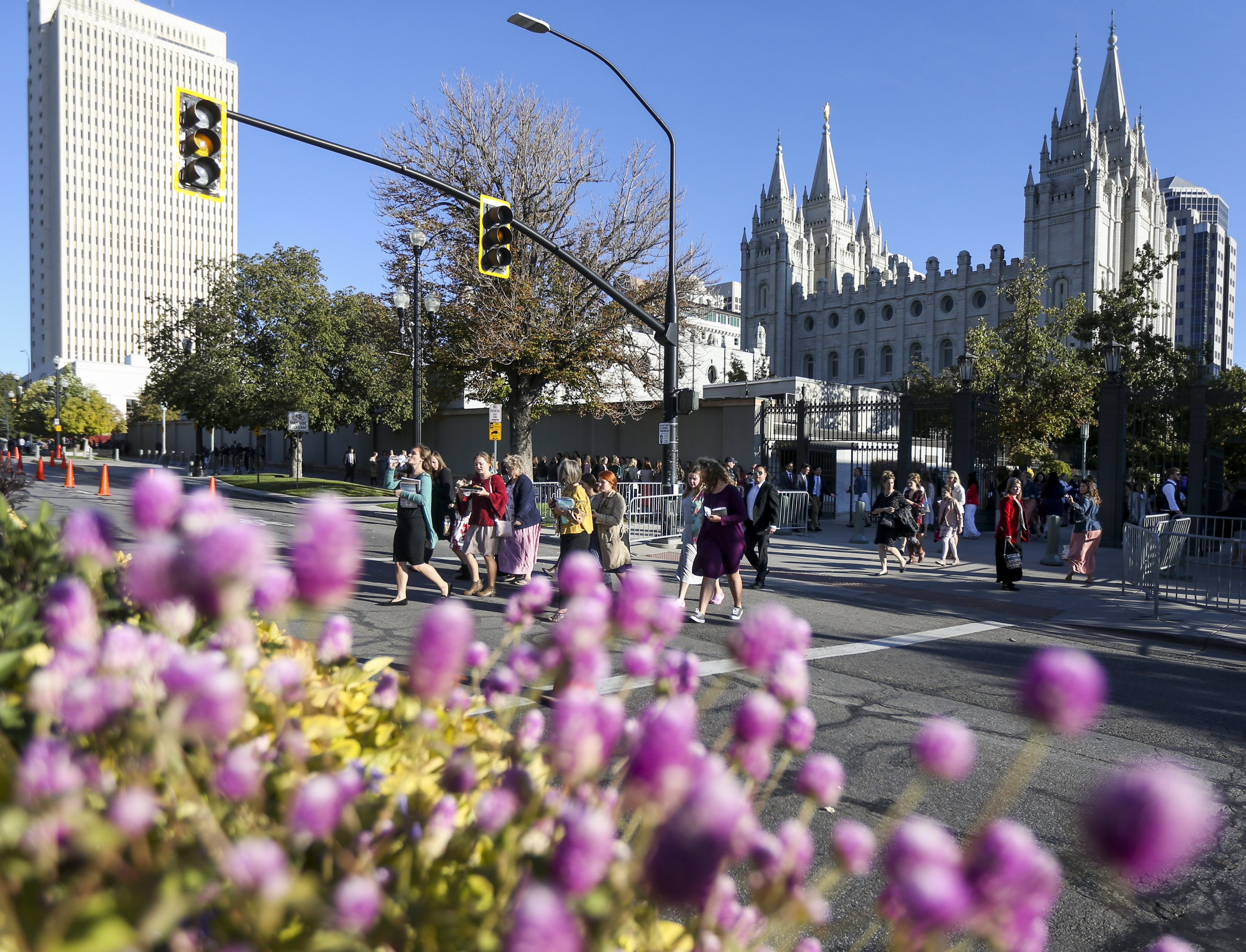 A group of women cross North Temple on their way to the Conference Center before the general women's session of the 189th Semiannual General Conference of The Church of Jesus Christ of Latter-day Saints in the Conference Center in Salt Lake City on Saturday, Oct. 5, 2019.