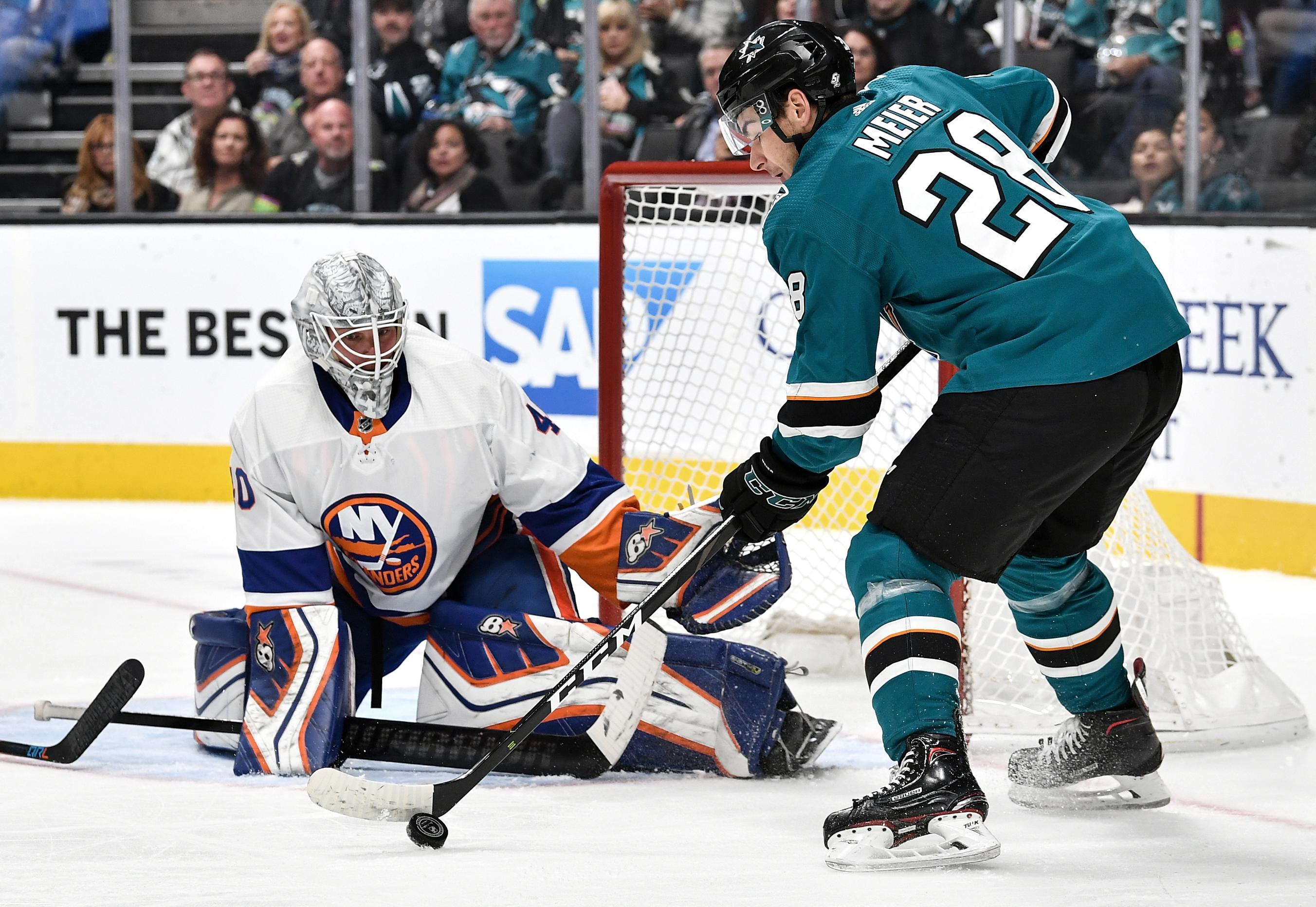 Timo Meier #28 of the San Jose Sharks looks to make a move against Robin Lehner #40 of the New York Islanders at SAP Center on October 20, 2018 in San Jose, California.