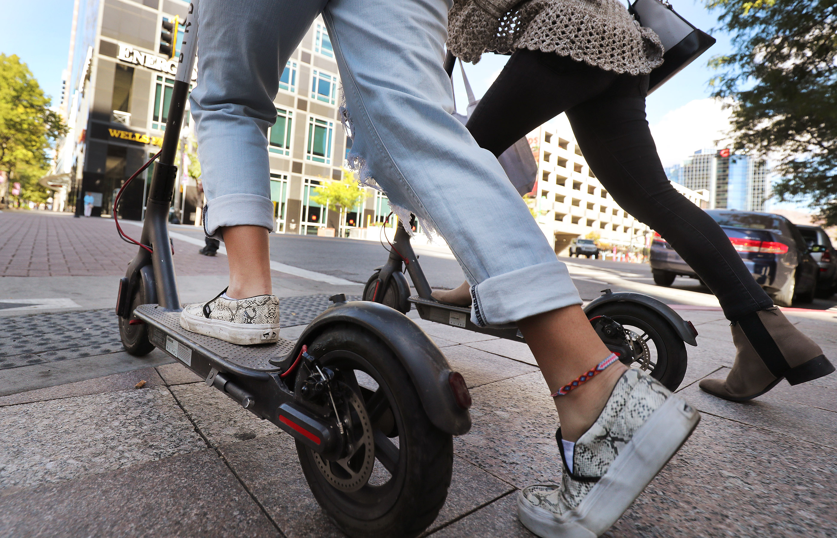 Bird scooters are ridden on Main Street in Salt Lake City on Friday, Oct. 5, 2018.
