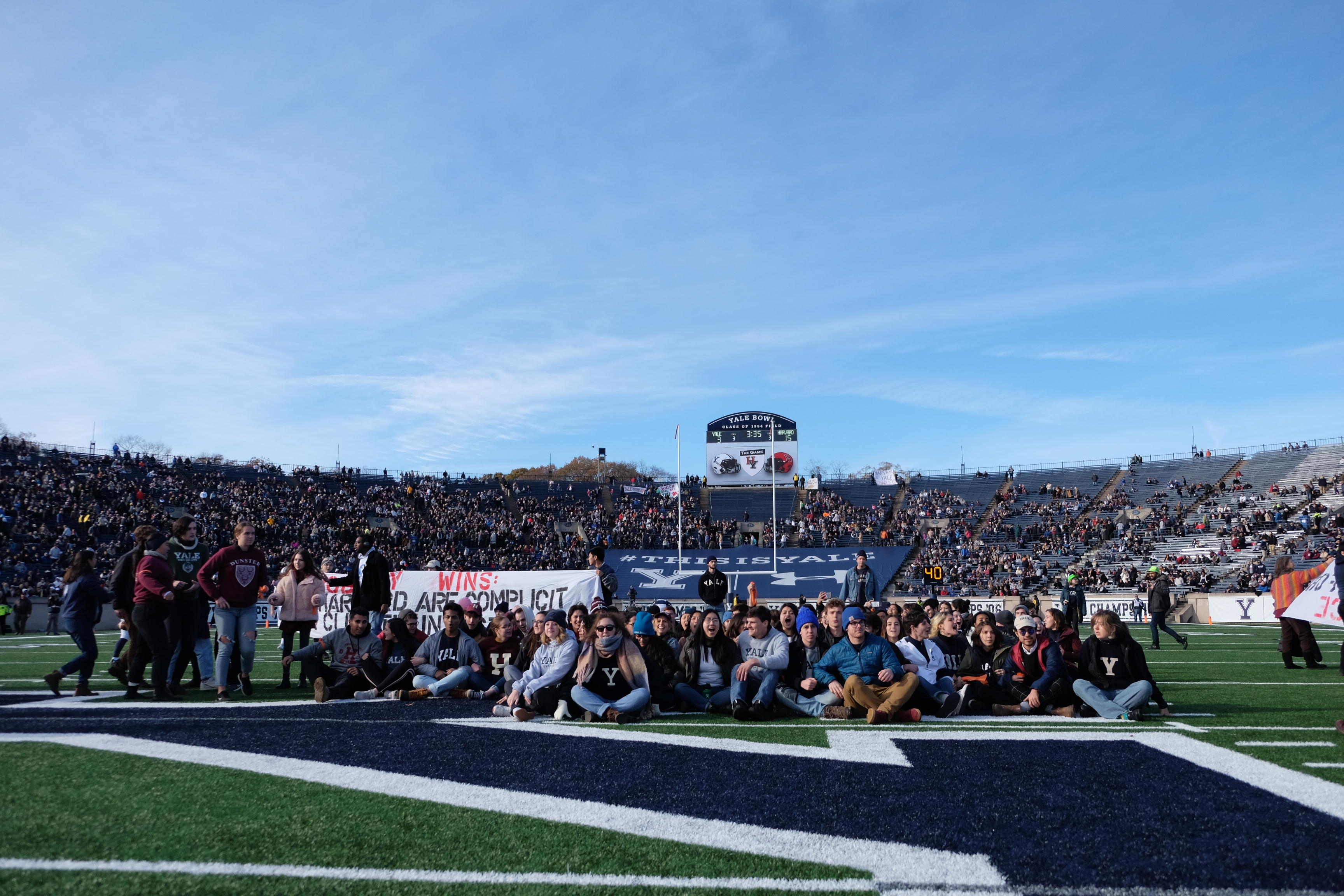 Climate activists brought Harvard-Yale football game to a stop to protest fossil fuel investments