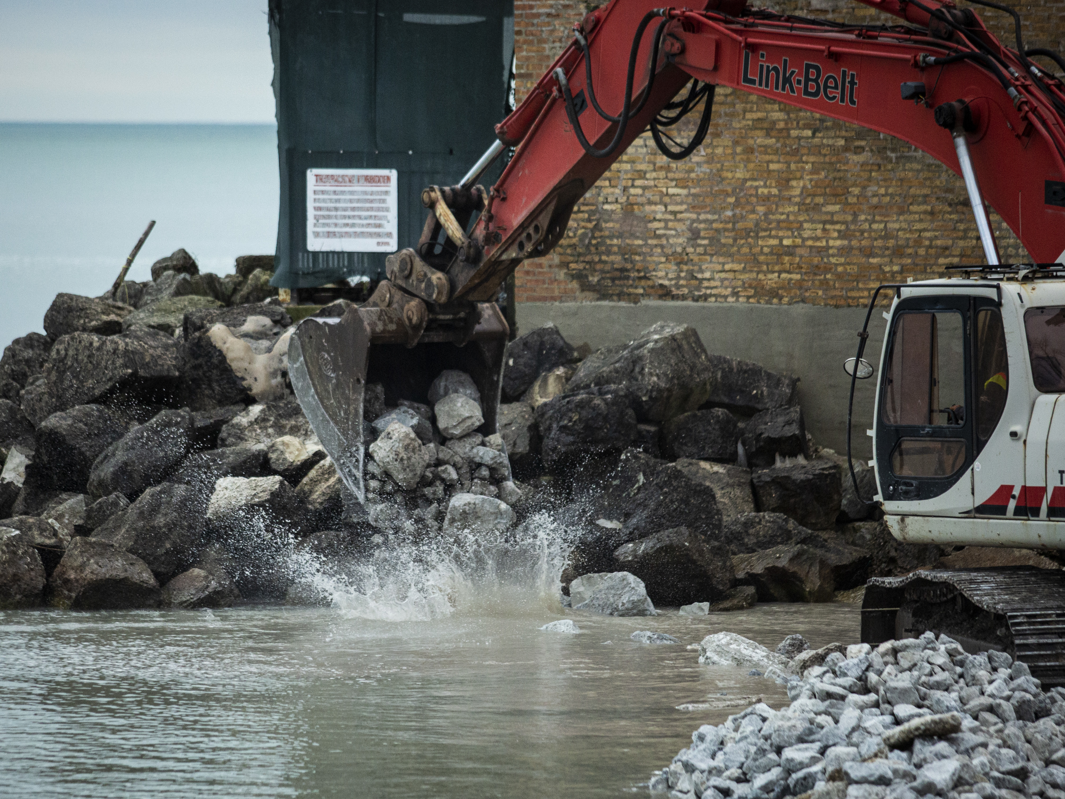 City workers unload boulders in an effort to slow erosion and protect the shoreline at Juneway Beach at the northeast tip of the Rogers Park neighborhood, Thursday afternoon, Nov. 21, 2019.