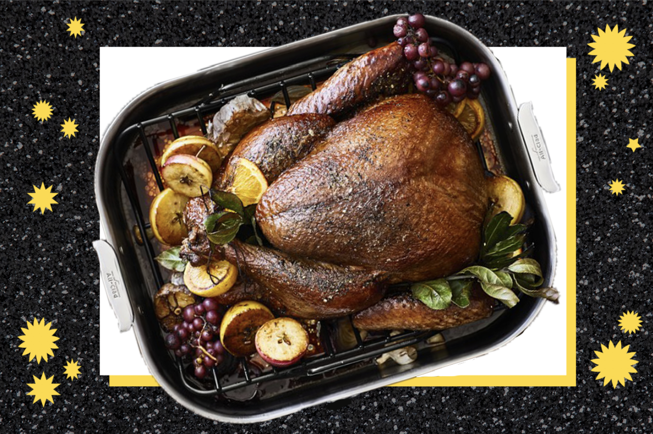 Turkey in an All-Clad roasting pan on a black sparkly background