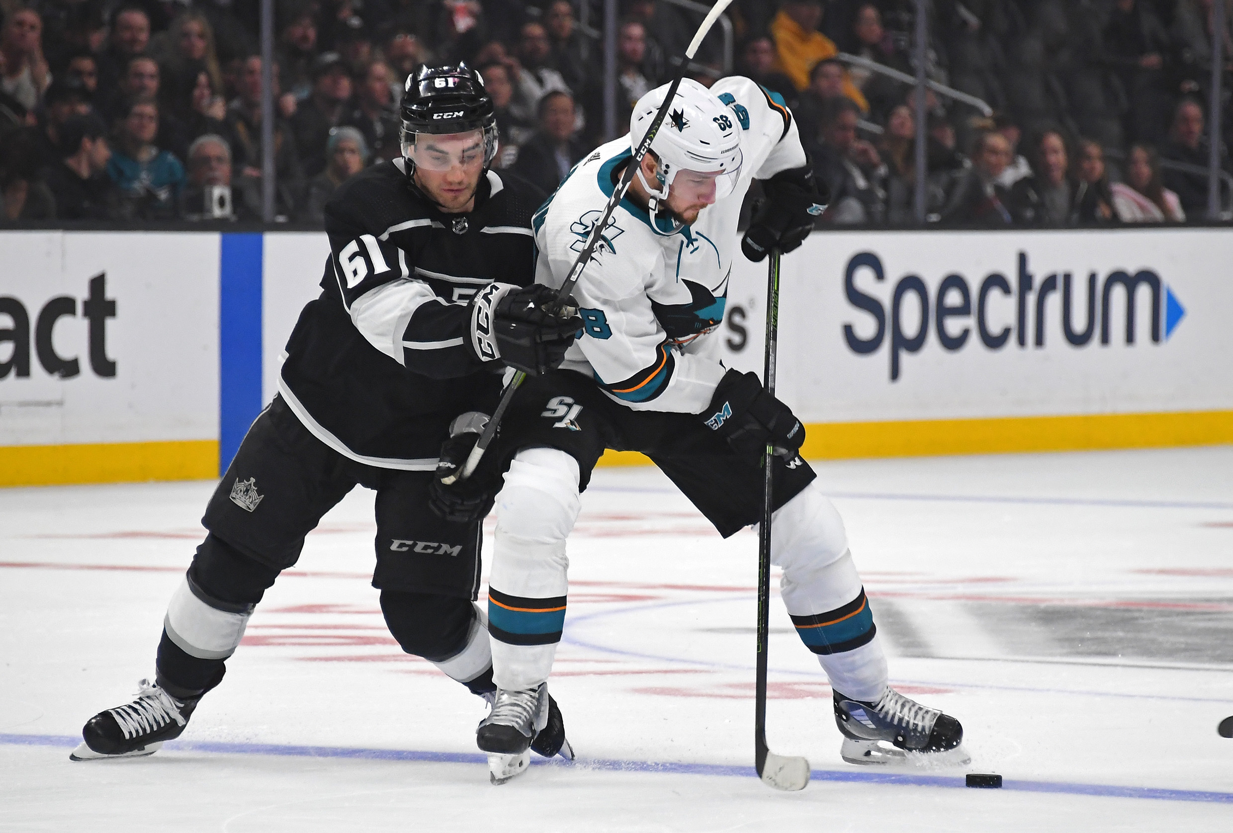 Mar 21, 2019; Los Angeles, CA, USA; Los Angeles Kings defenseman Sean Walker (61) and San Jose Sharks center Melker Karlsson (68) battle for the puck in the third period of the game at Staples Center.