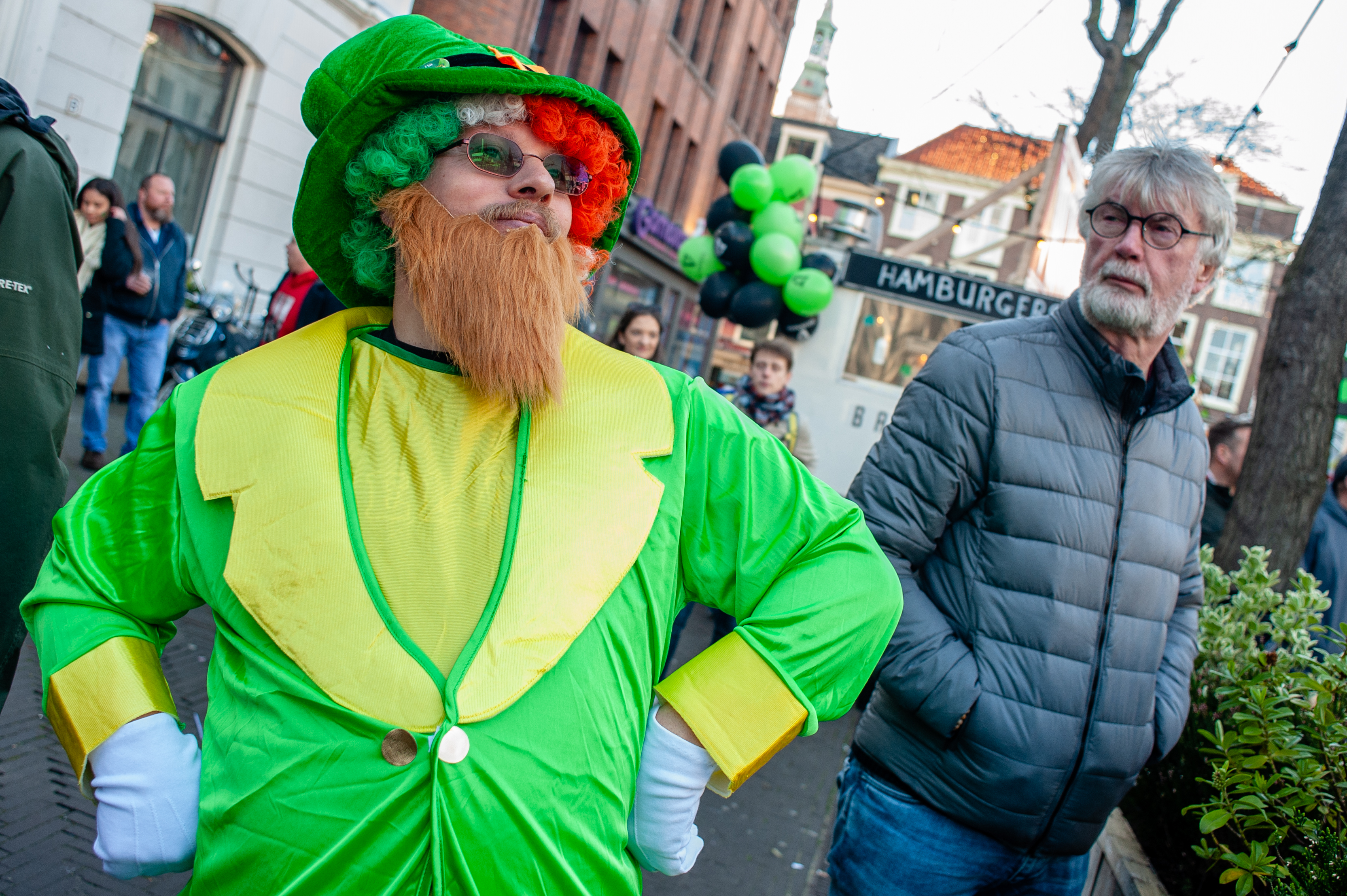 A man is seen wearing a leprechaun costume during the...