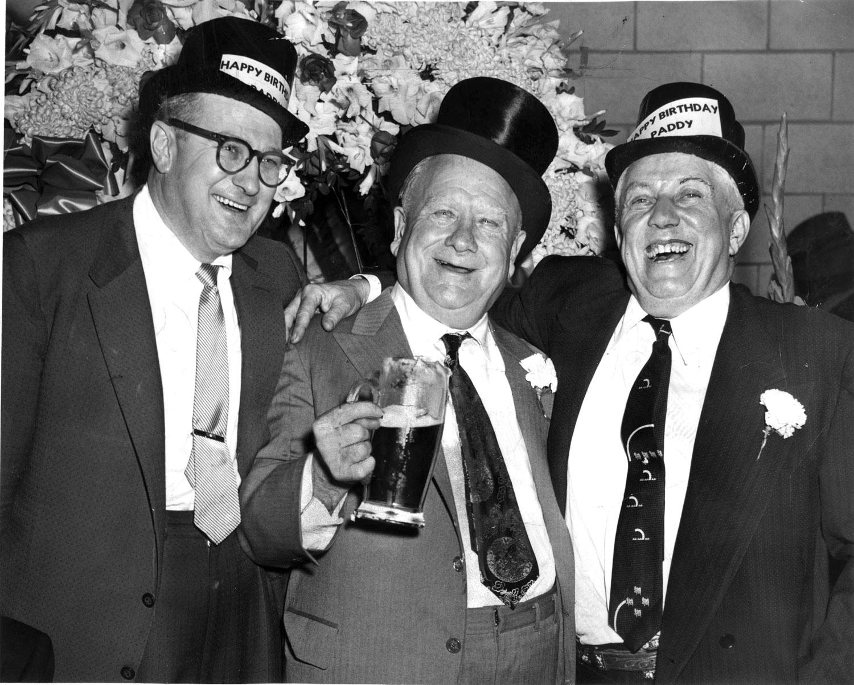 "Ald. Mathias ""Paddy"" Bauler, center, celebrating his 66th birthday in 1956"