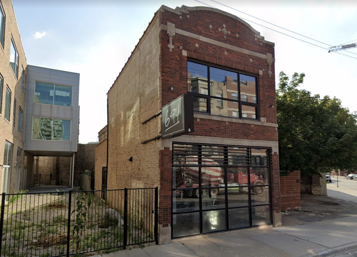 A two-story standalone brick building.