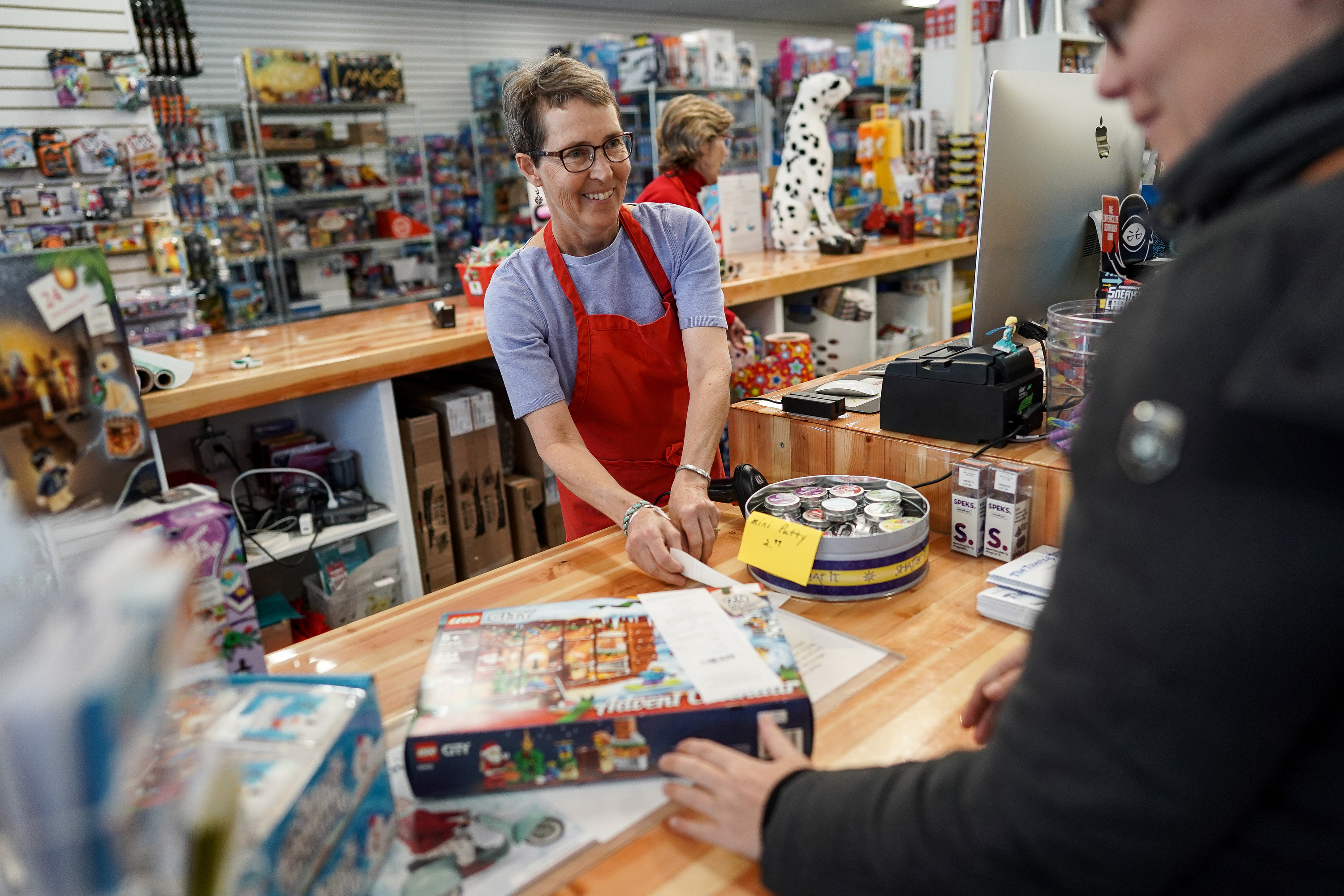 Swantje Johnson rings up customer Ashleigh Moore at The Tutoring Toy in Salt Lake City on Tuesday, Nov. 26, 2019.