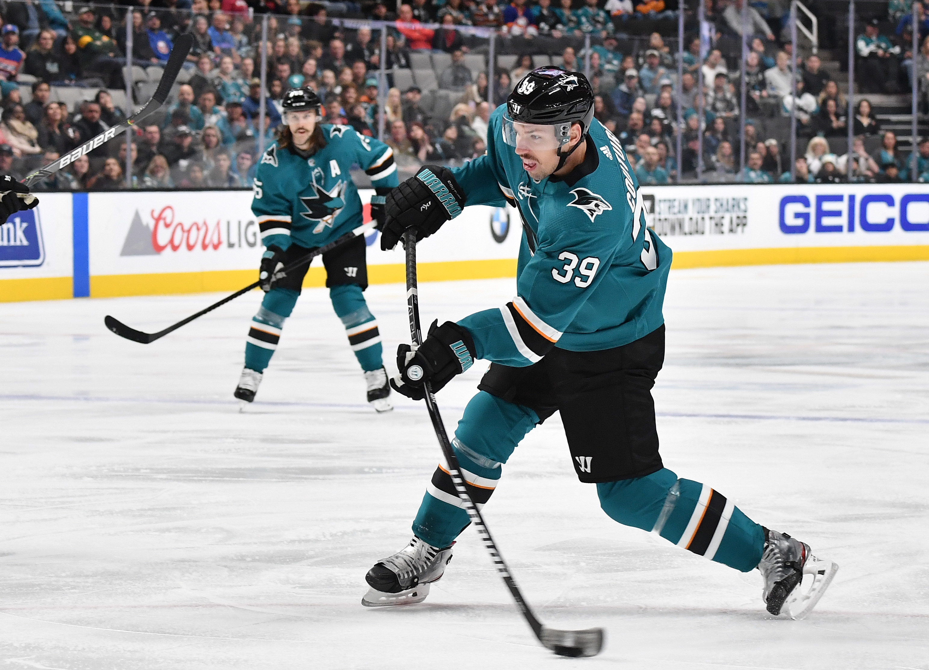 SAN JOSE, CA - NOVEMBER 23: Logan Couture #39 of the San Jose Sharks shoots the puck against the New York Islanders at SAP Center on November 23, 2019 in San Jose, California.