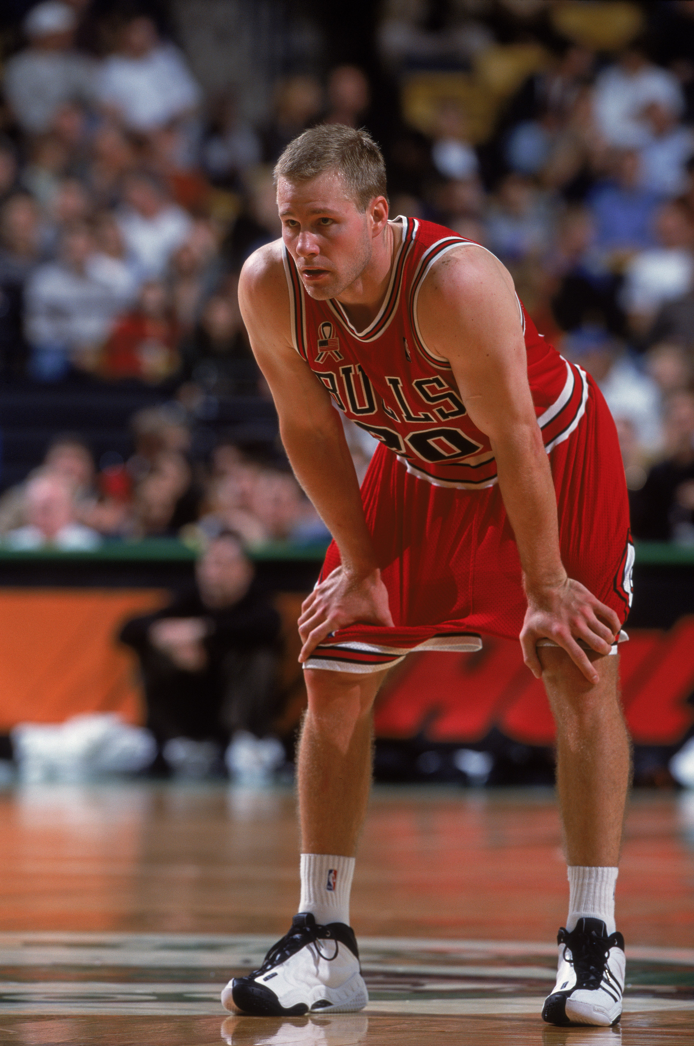 Fred Hoiberg rests his hands on his knees