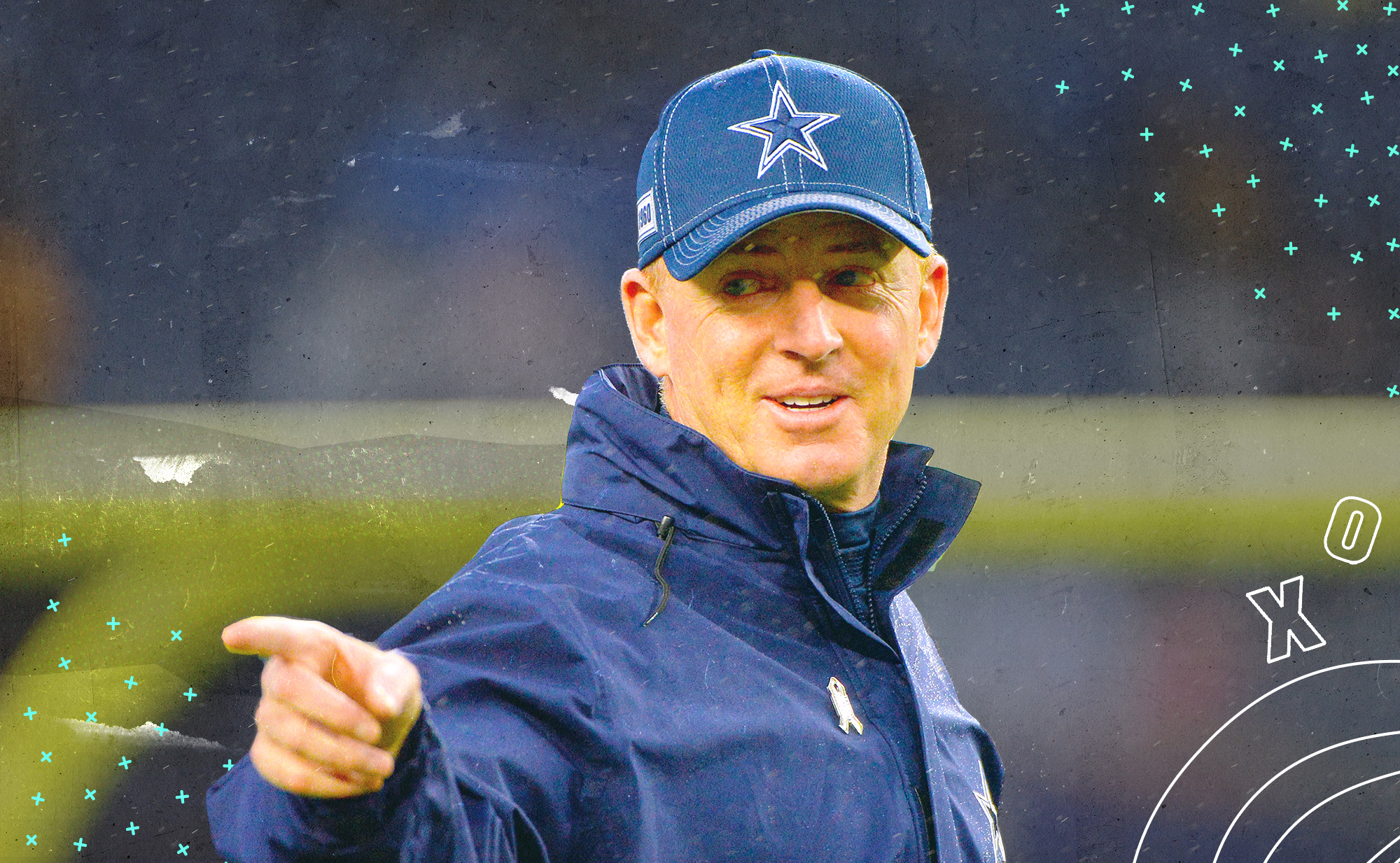 Cowboys head coach Jason Garrett, wearing a hat with the Dallas star, points with his right finger