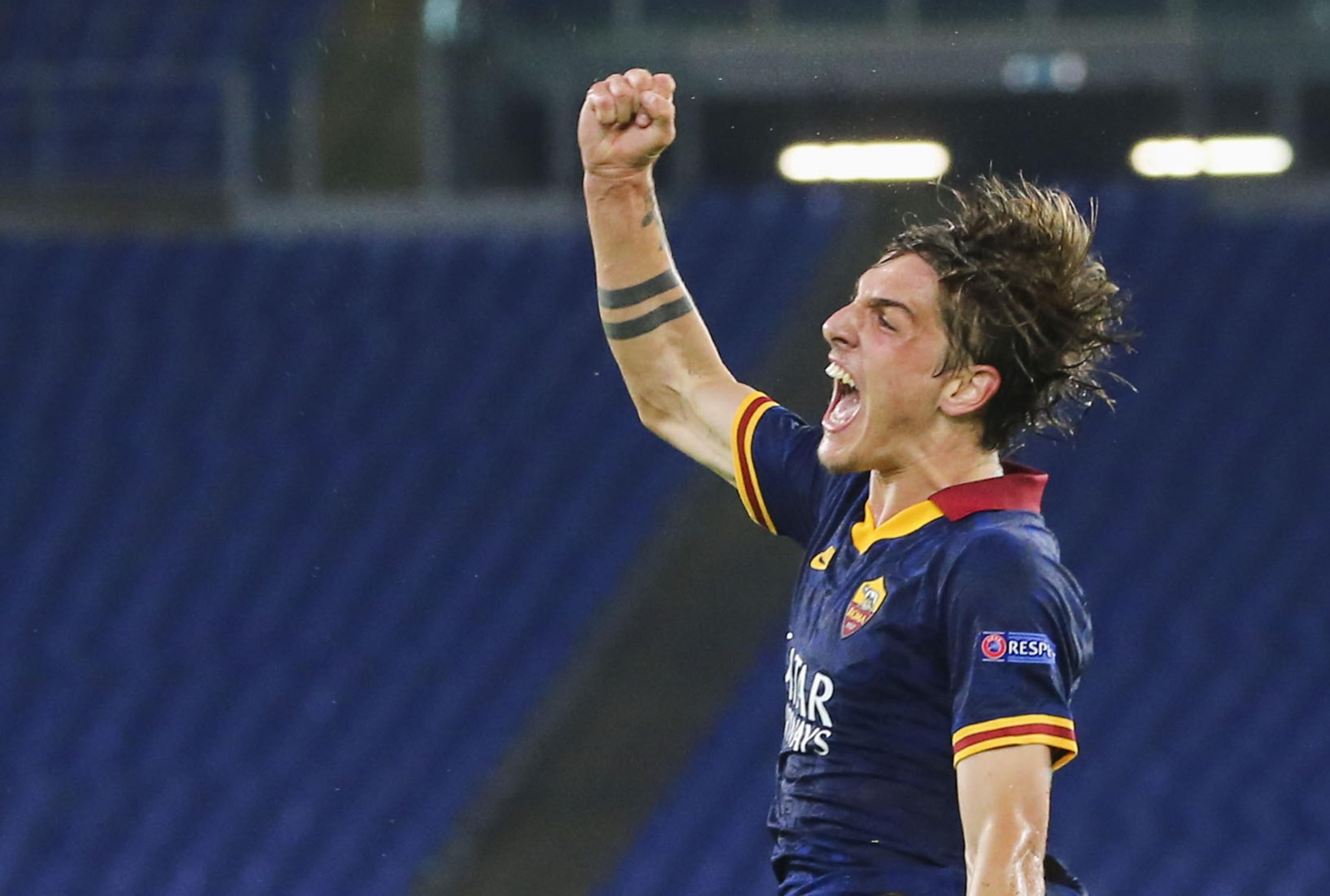 Roma's Italian midfielder Nicolo Zaniolo celebrates after...