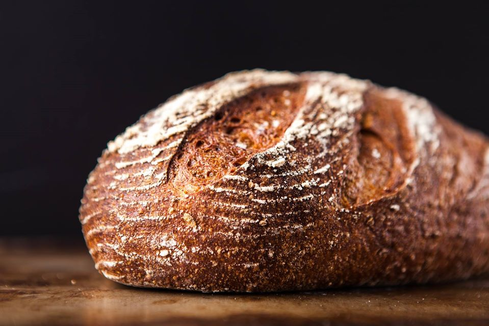 A picture of a loaf of hazelnut-brown bread from Grand Central Bakery