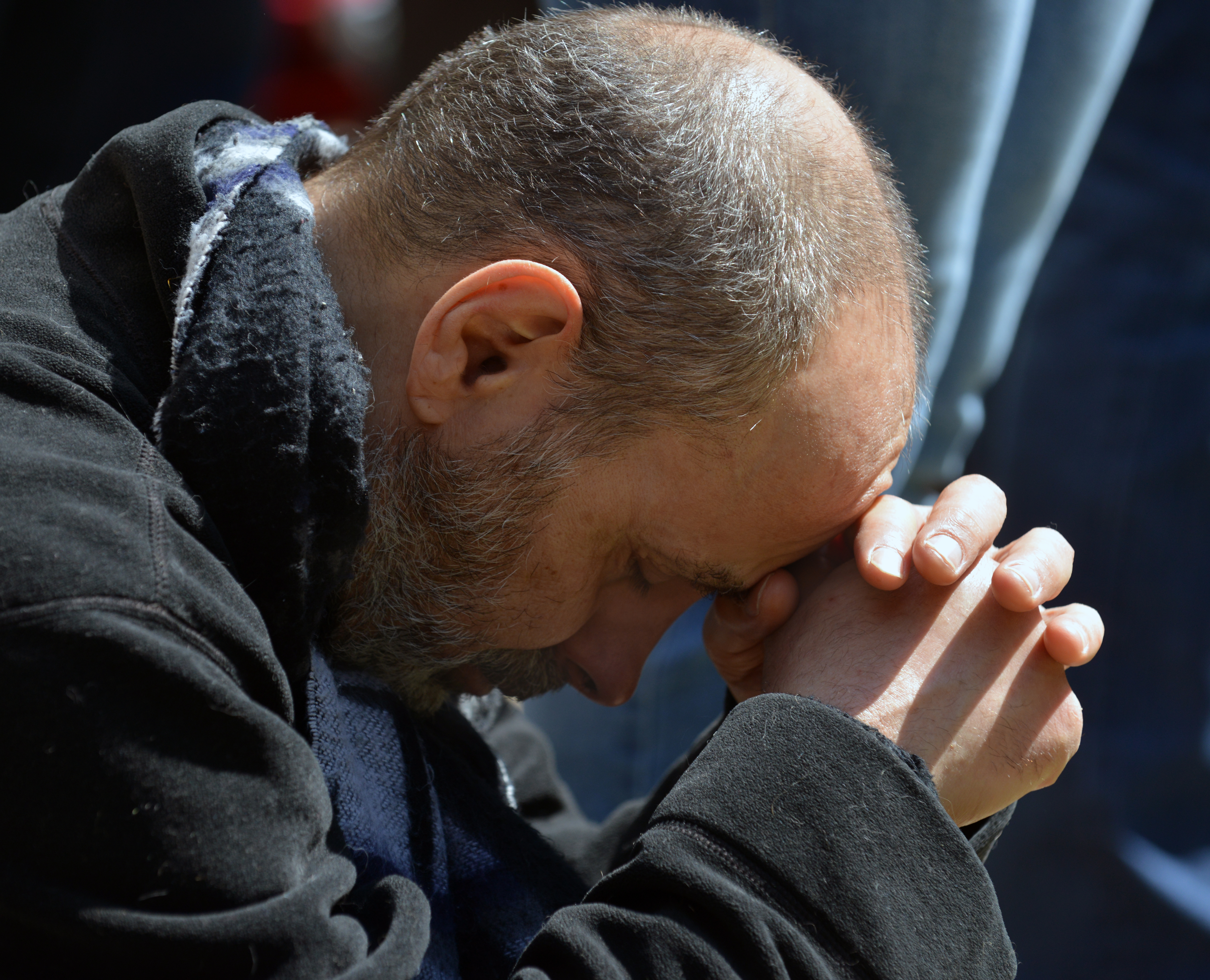A Chicagoan prays at Holy Name Cathedral