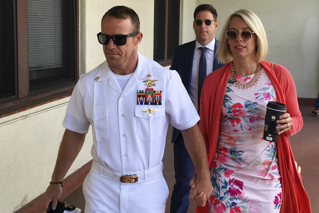 Navy Special Operations Chief Edward Gallagher, left, walks with his wife, Andrea Gallagher as they arrive to military court on Naval Base San Diego, Monday, July 1, 2019, in San Diego. The trial continued Monday in the court-martial of the decorated Navy