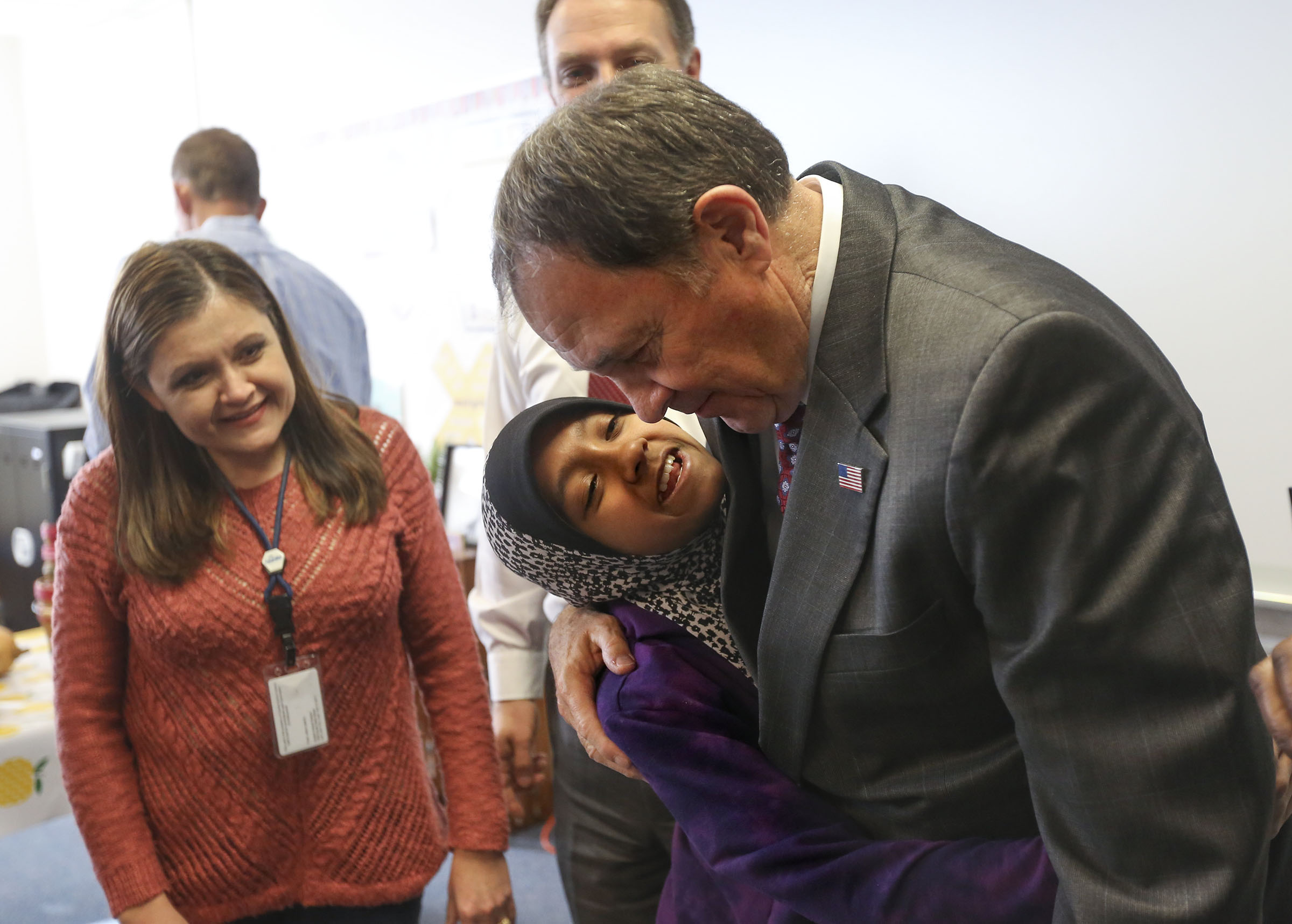 Zaidah Mohamad hugs Gov. Gary Herbert after Herbert proclaimed Tuesday, Nov. 26, 2019, as Harvest Gratitude Day during an event at Lincoln Elementary School in South Salt Lake.