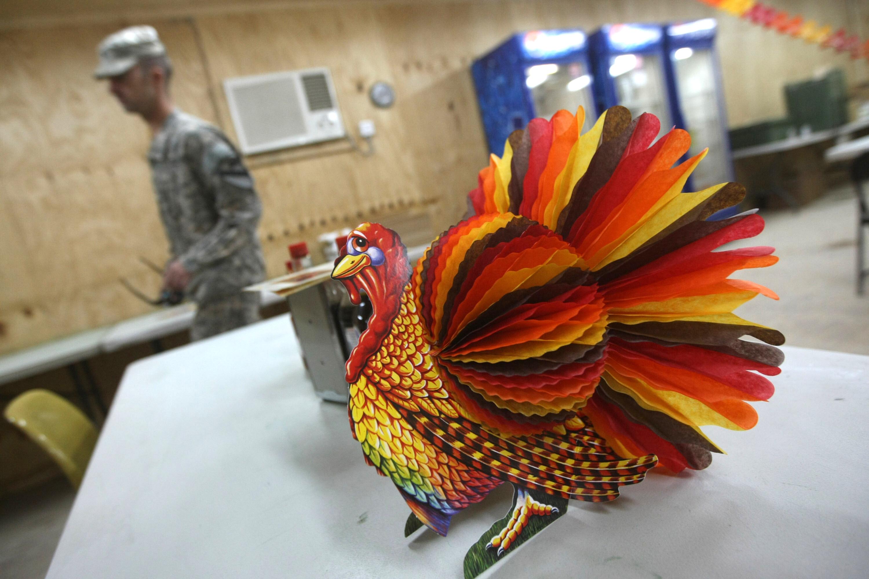 A US soldier walks past a decorative pap