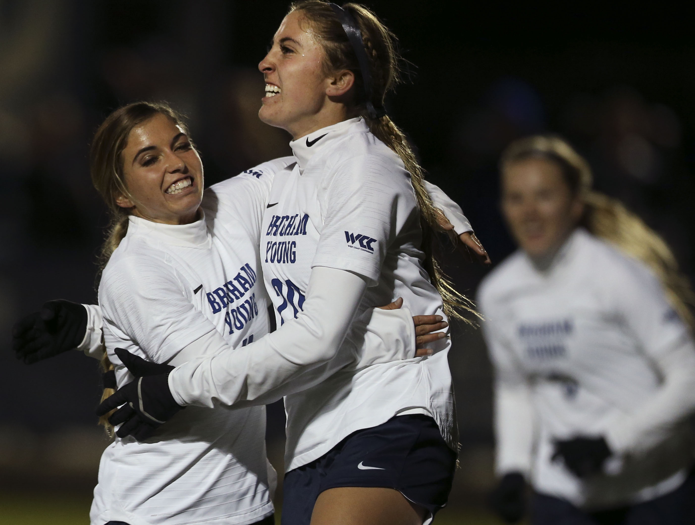 BYU's Lizzy Braby and Cameron Tucker celebrate Tucker's goal against Louisville during the NCAA soccer tournament at BYU in Provo on Thursday, Nov. 21, 2019.