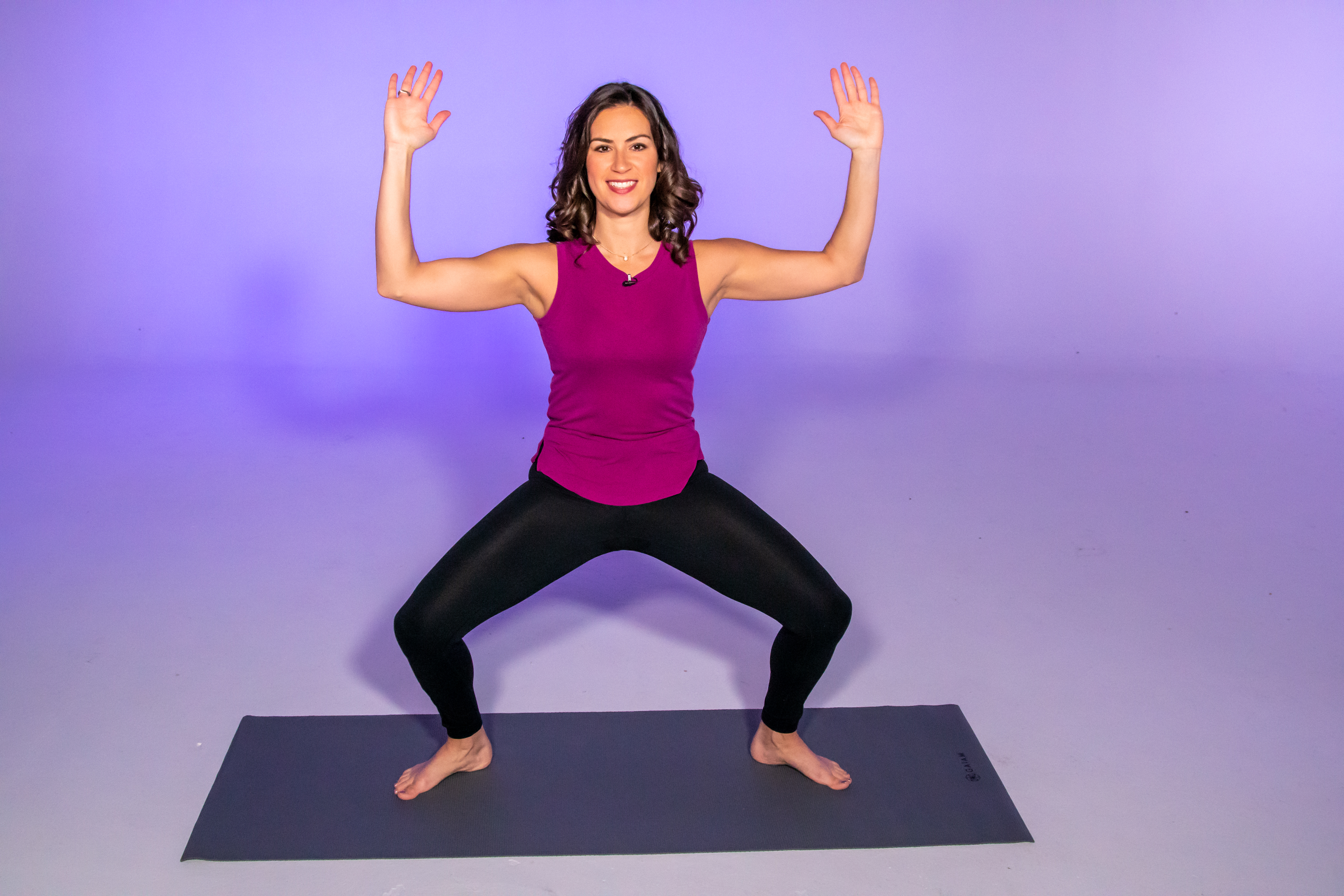Health and fitness expert Stephanie Mansour demonstrates a horse or goddess pose, which is part of her centering yoga workout. | Brian Ernst/Sun-Times