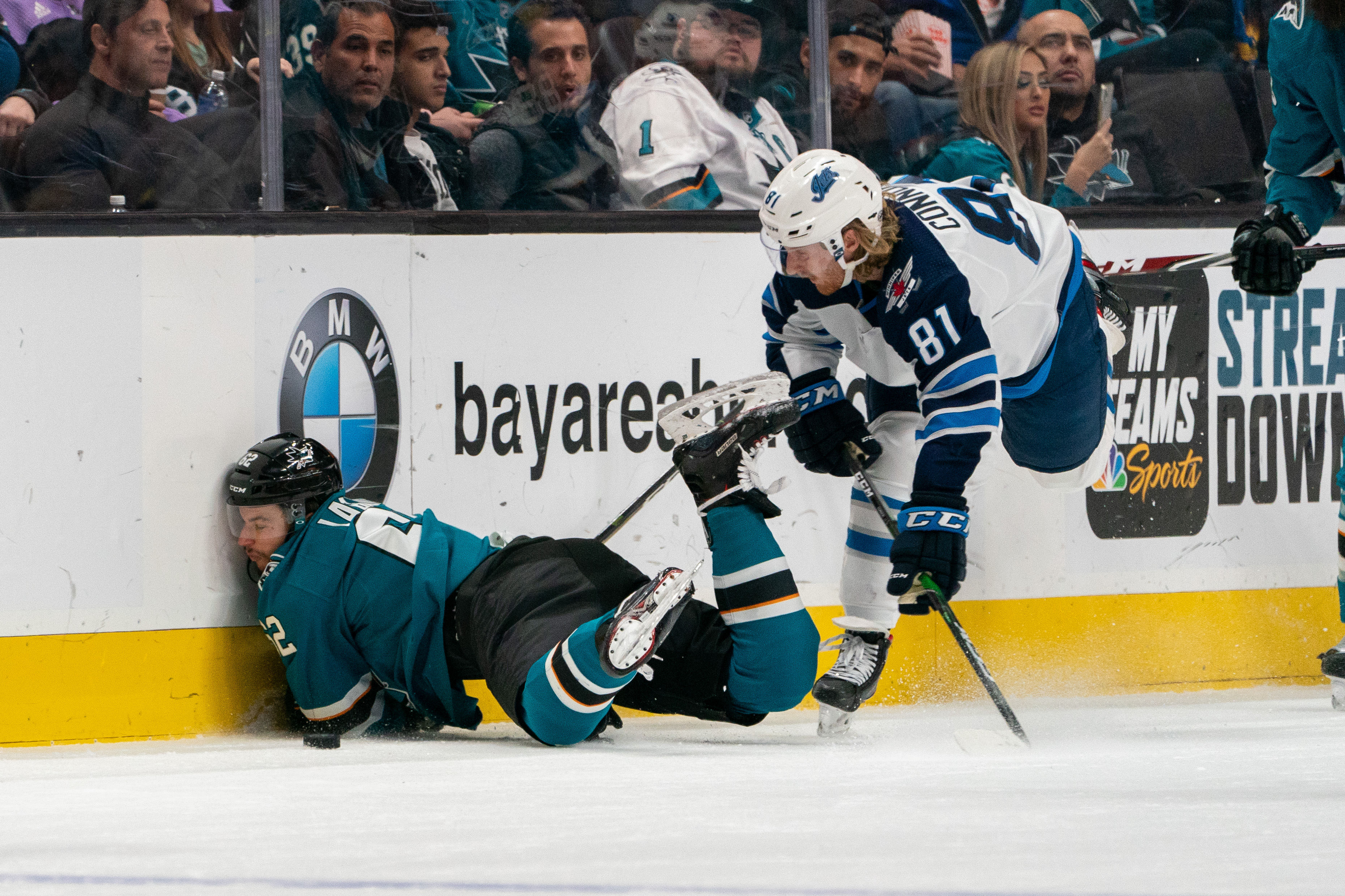 Nov 27, 2019; San Jose, CA, USA; San Jose Sharks right wing Kevin Labanc (62) is checked into the boards by Winnipeg Jets left wing Kyle Connor (81) during the second period at SAP Center at San Jose.