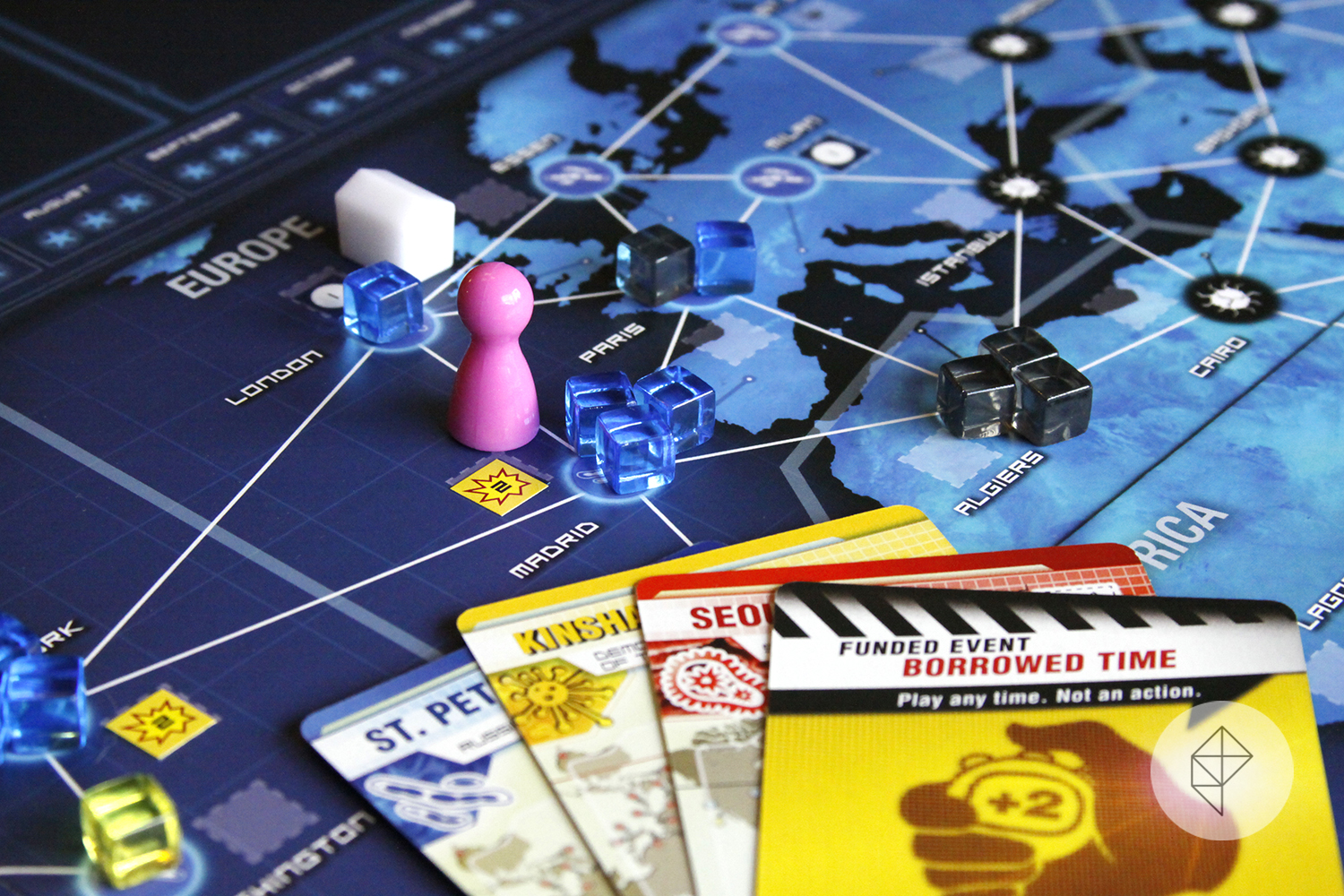 Pandemic: Legacy board showing several disease cubes and a few cards for dealing with them.
