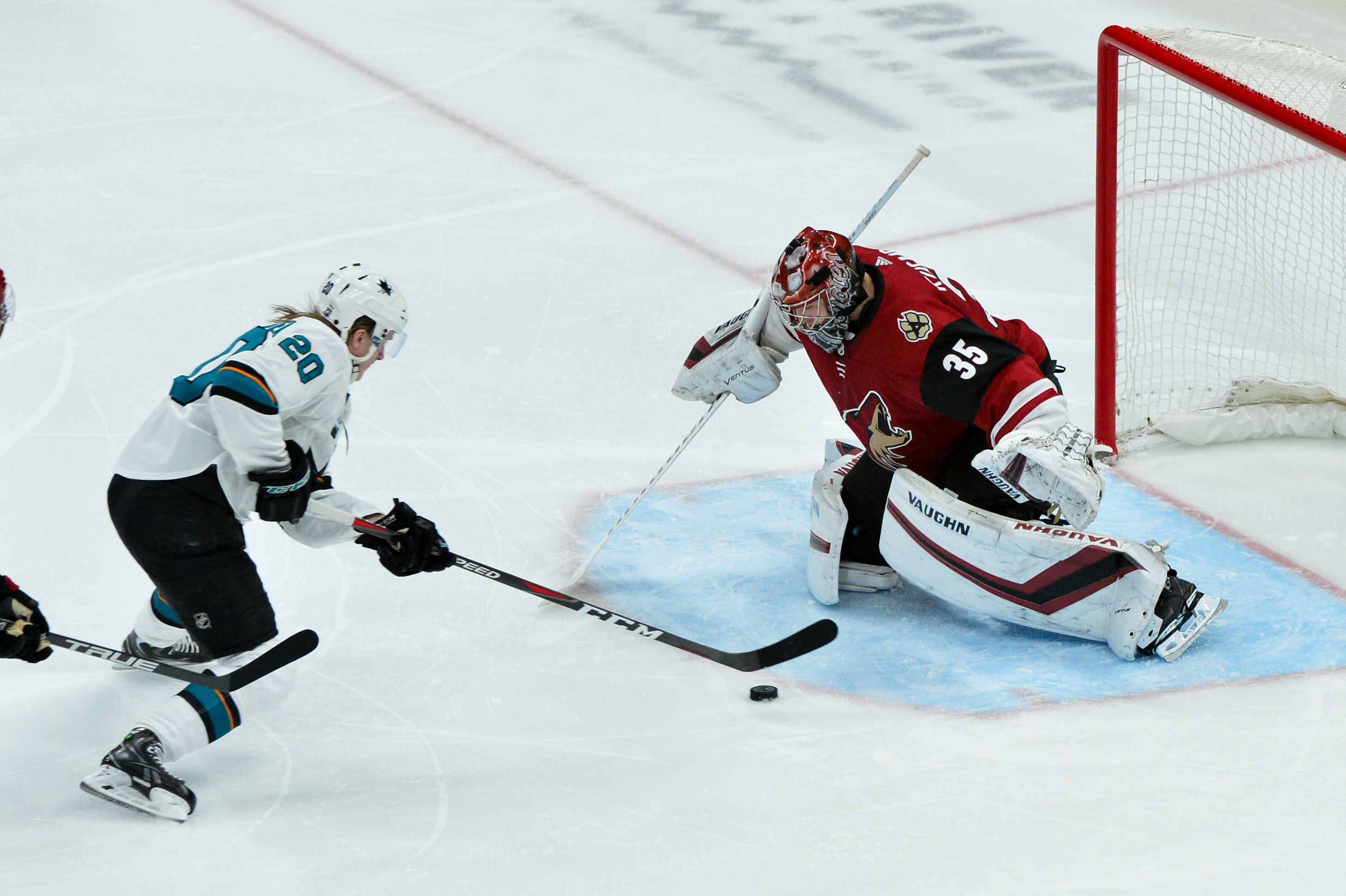 Jan 16, 2019; Glendale, AZ, USA; Arizona Coyotes goaltender Darcy Kuemper (35) makes a save on San Jose Sharks left wing Marcus Sorensen (20) during the second period at Gila River Arena.