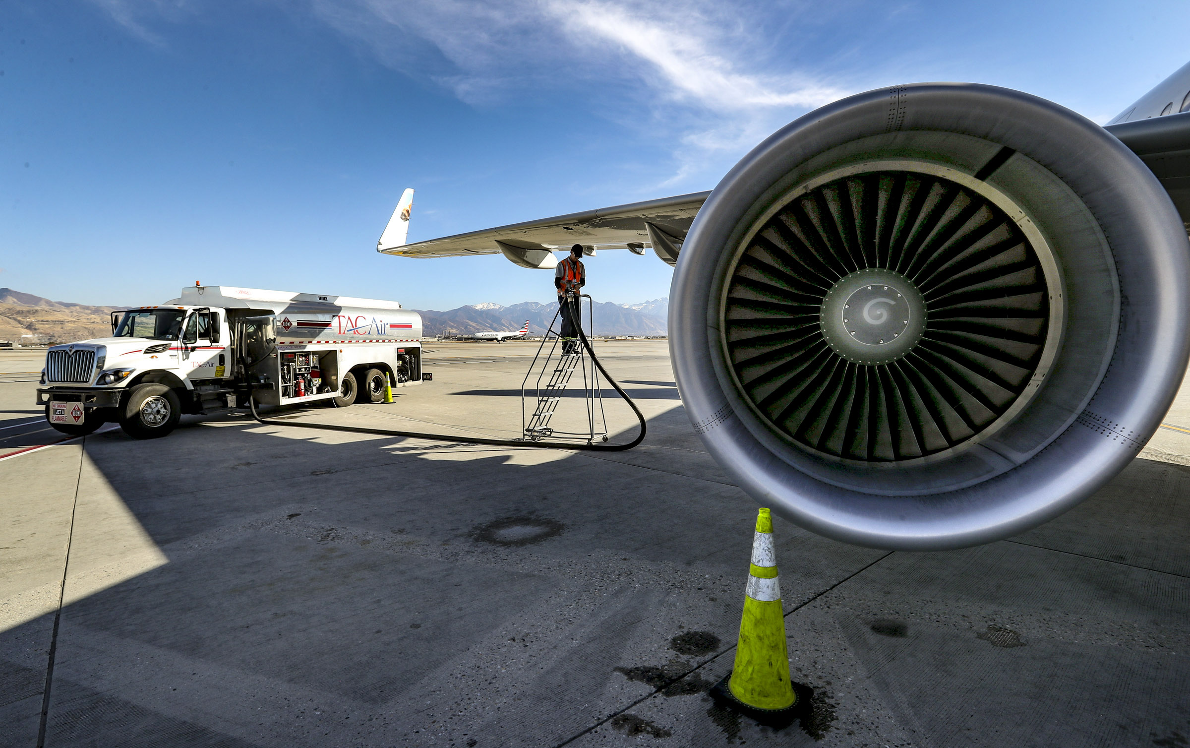 Aircraft technician Kevin Hines disconnects a fuel line from a Frontier passenger jet after refueling it from a tanker truck at the Salt Lake City International Airport on Monday, Nov. 11, 2019.