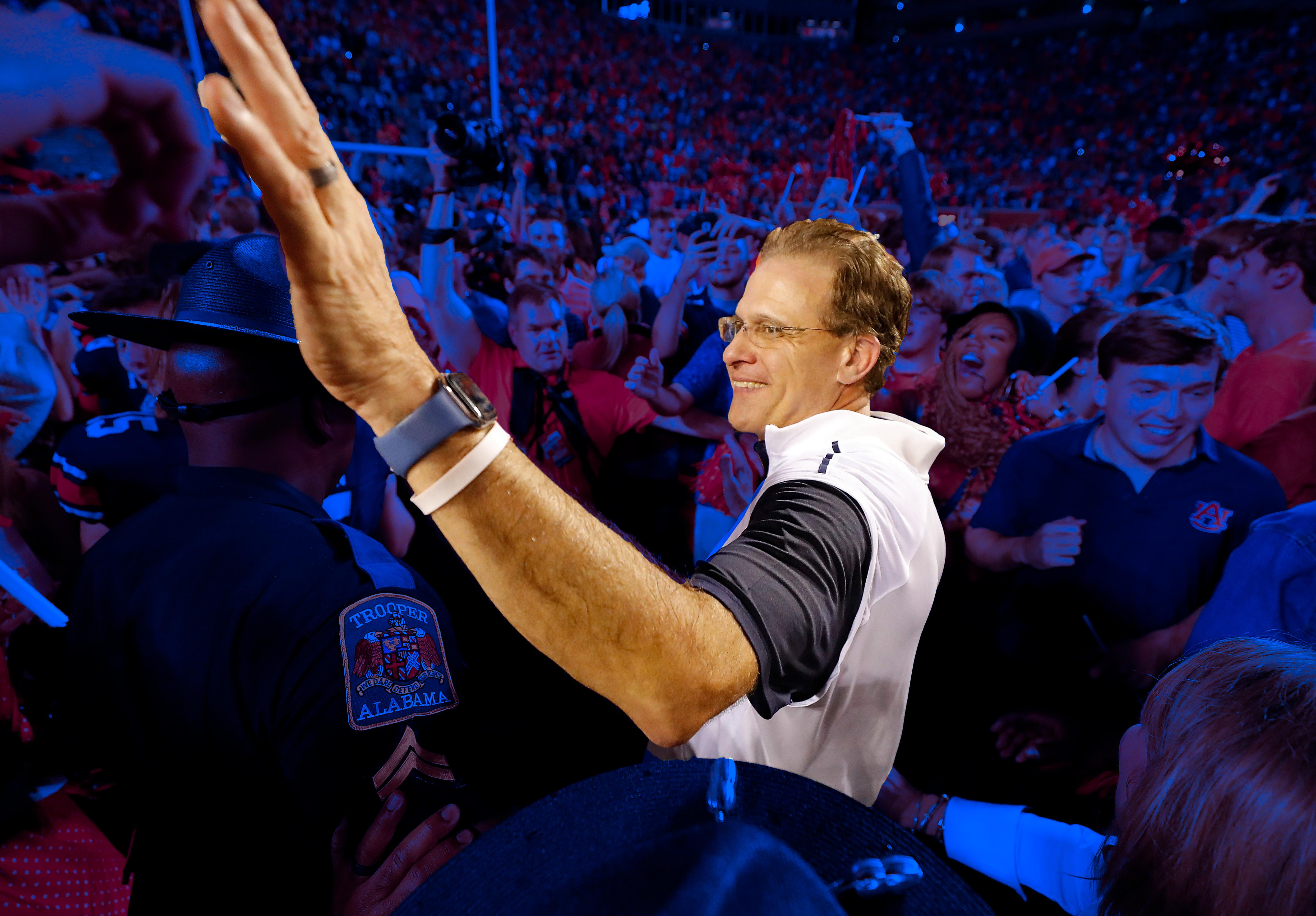 Gus Malzahn celebrates Auburn beating Alabama.