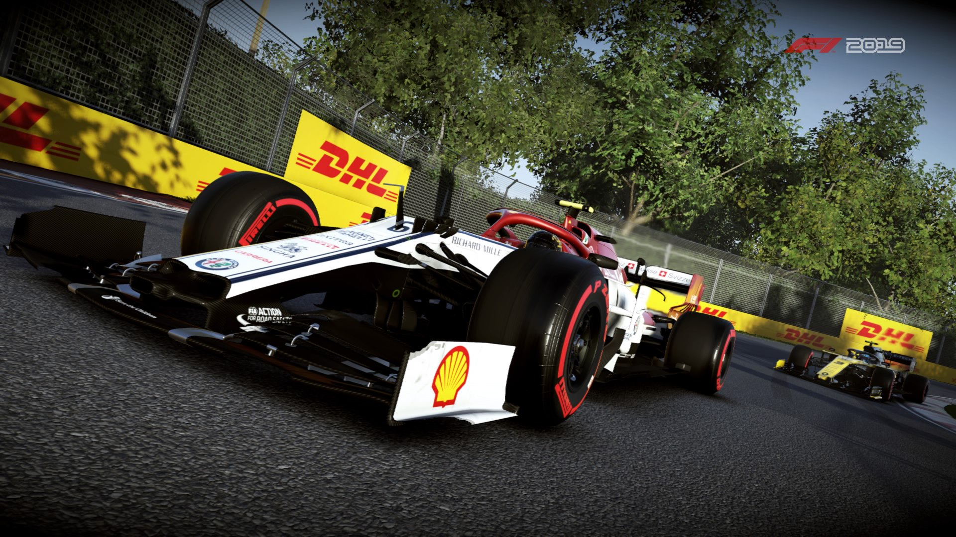 An F1 race car zooms around a corner ahead of a close rival