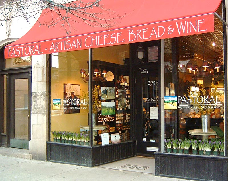 A storefront with red awning