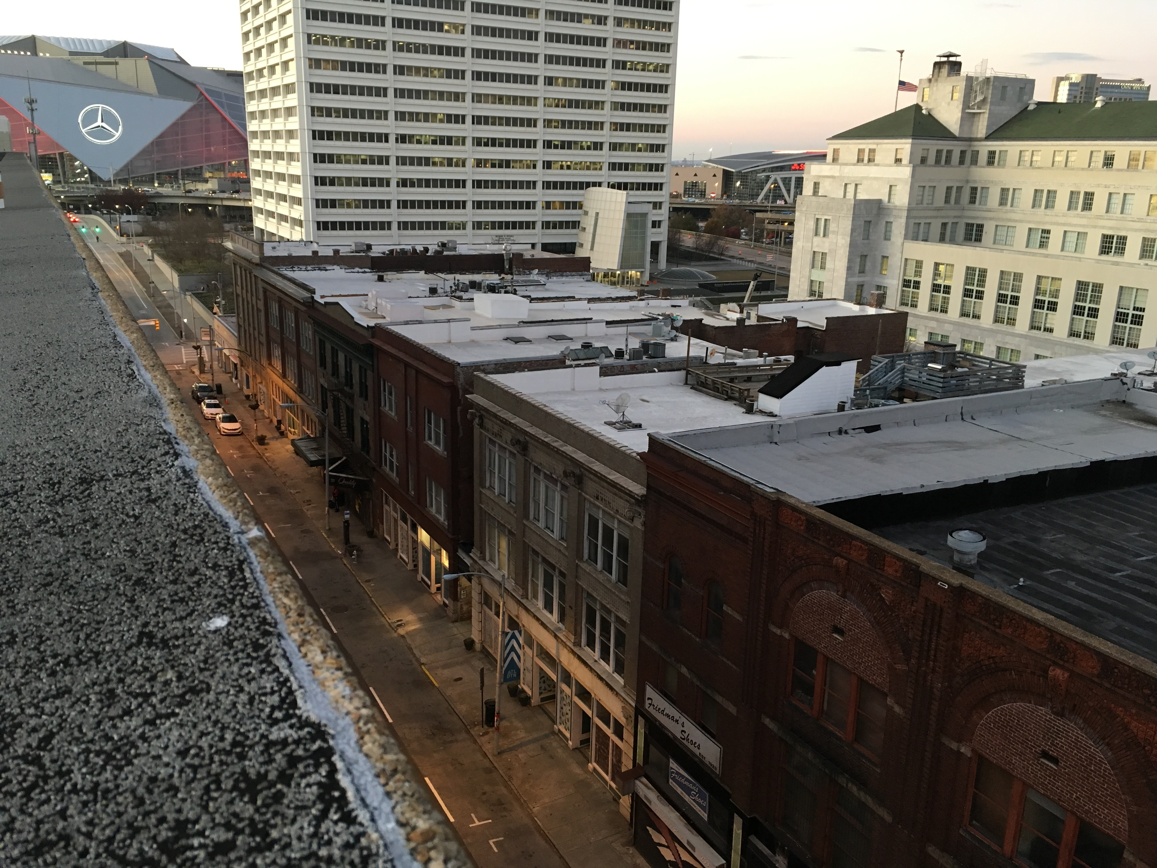 A look down a long street of old rooftops that leads to Mercedes-Benz Stadium.