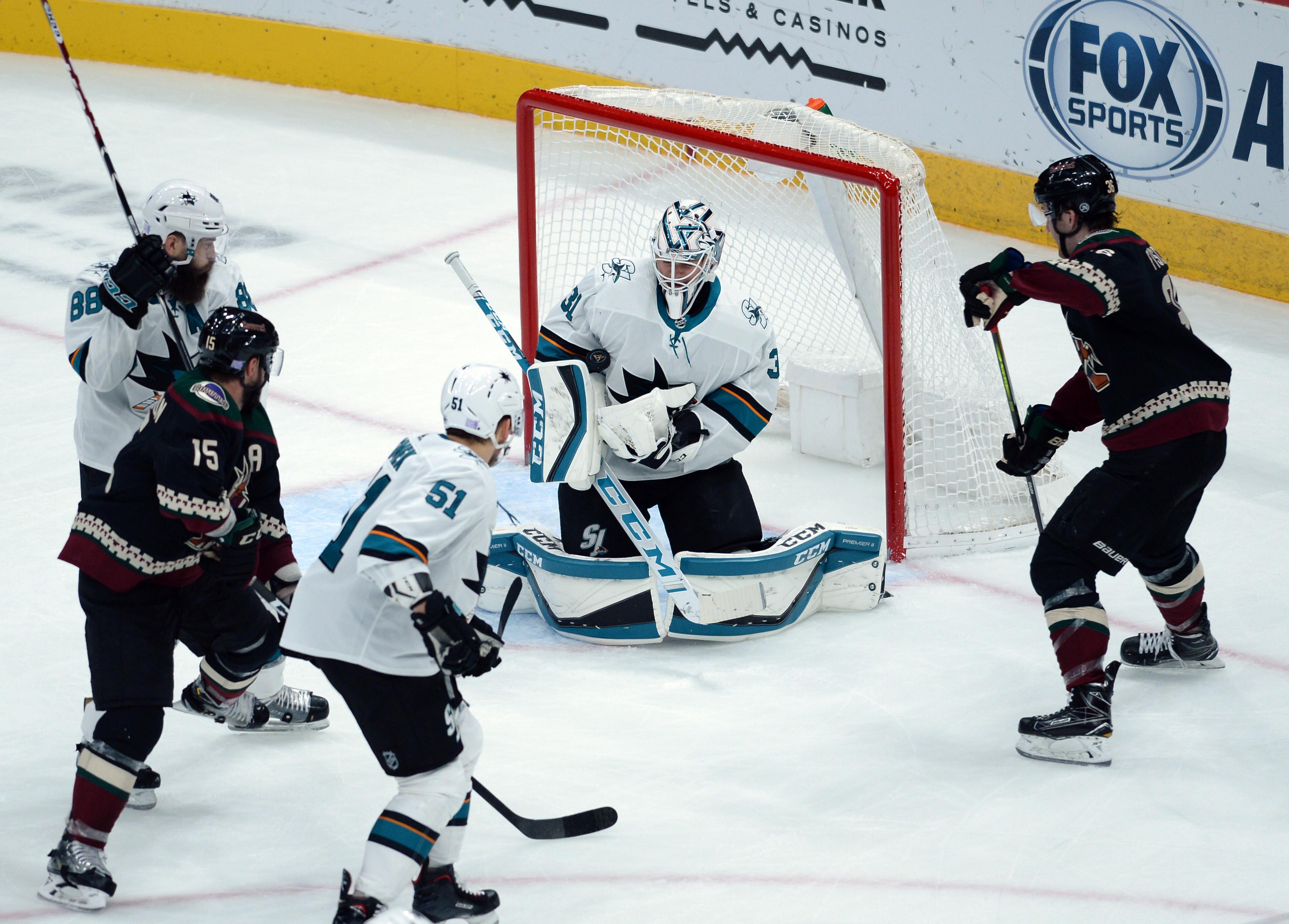 Nov 30, 2019; Glendale, AZ, USA; San Jose Sharks goaltender Martin Jones (31) makes a save against the Arizona Coyotes during the second period at Gila River Arena.