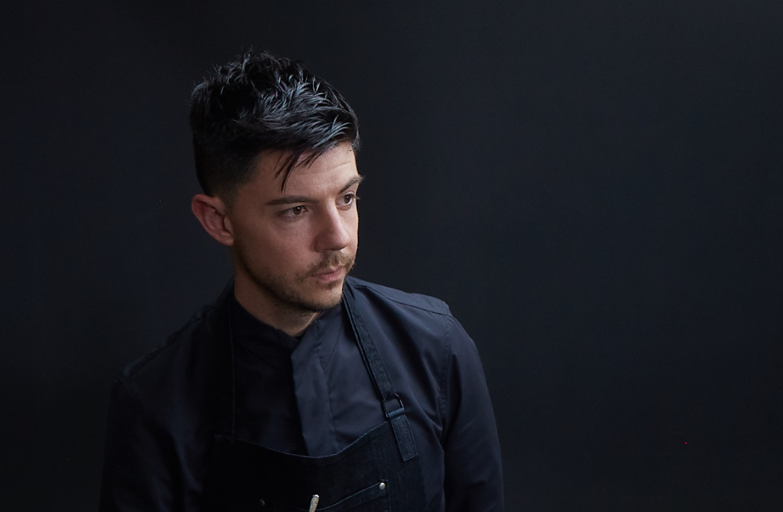 Photo of chef Joe Geiskopf with a dark background.