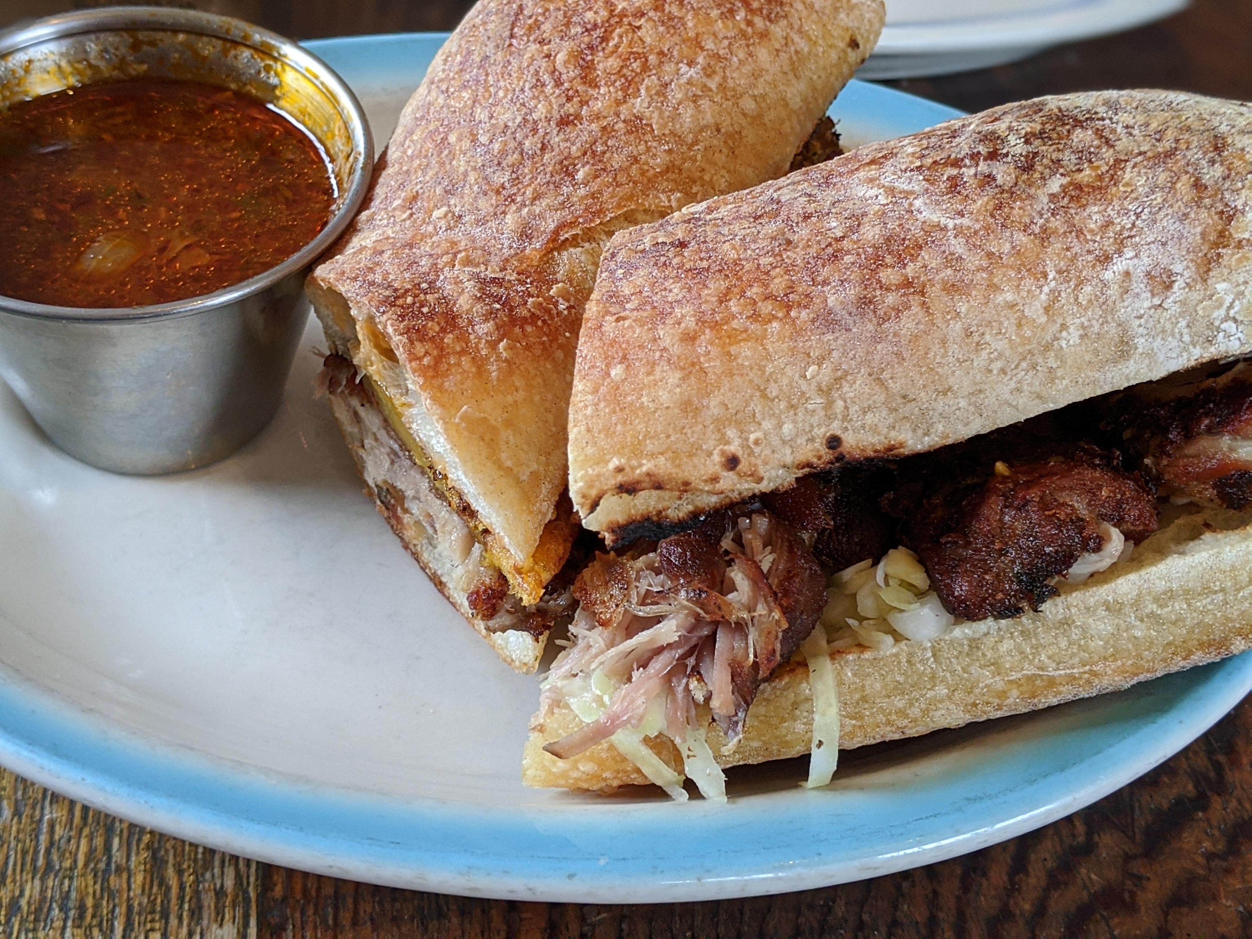 Haiti's Hallmark Fried Pork Dish Turns Into a Uniquely Flavorful Sandwich