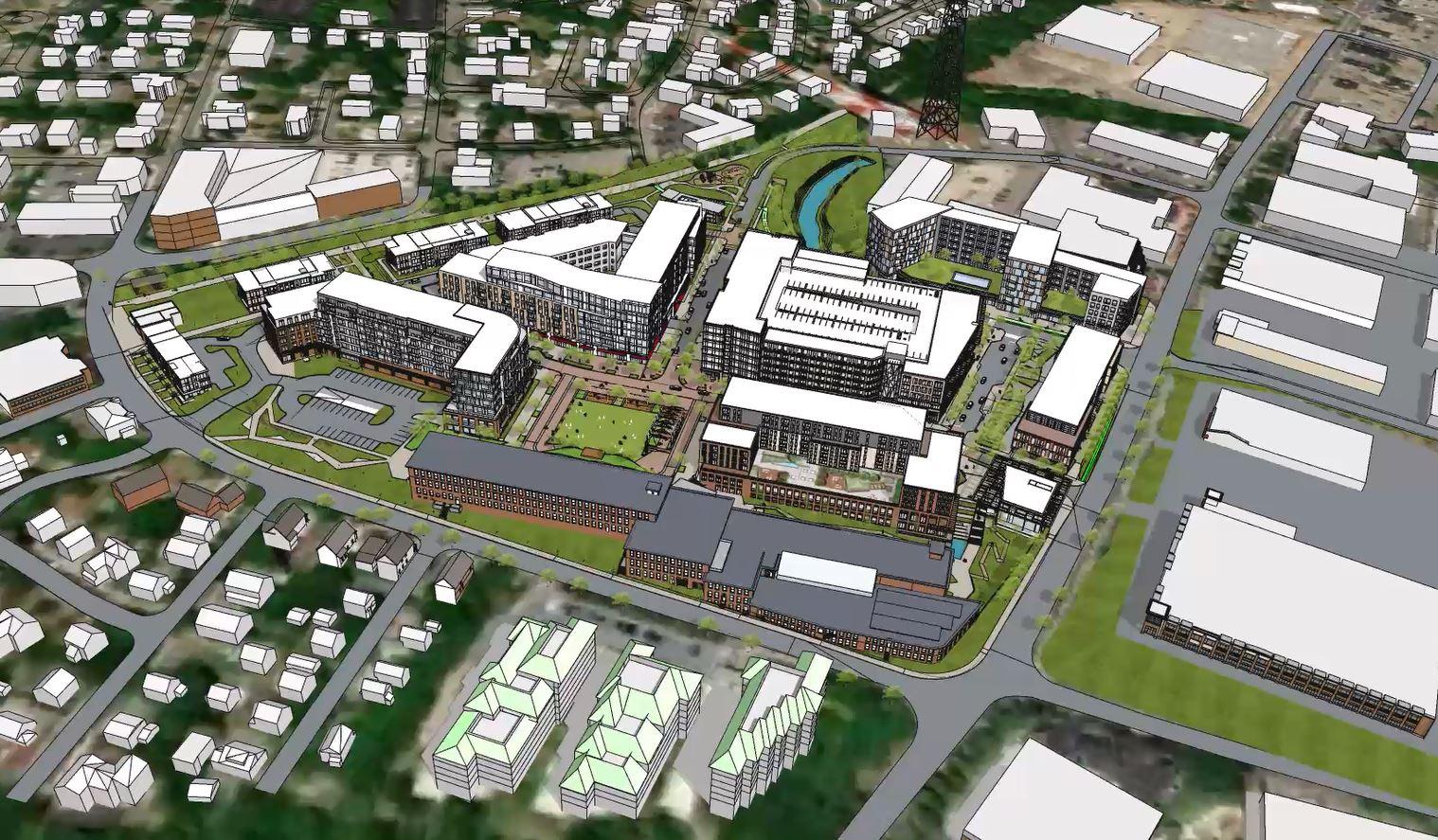 Aerial rendering of a multi-building development.