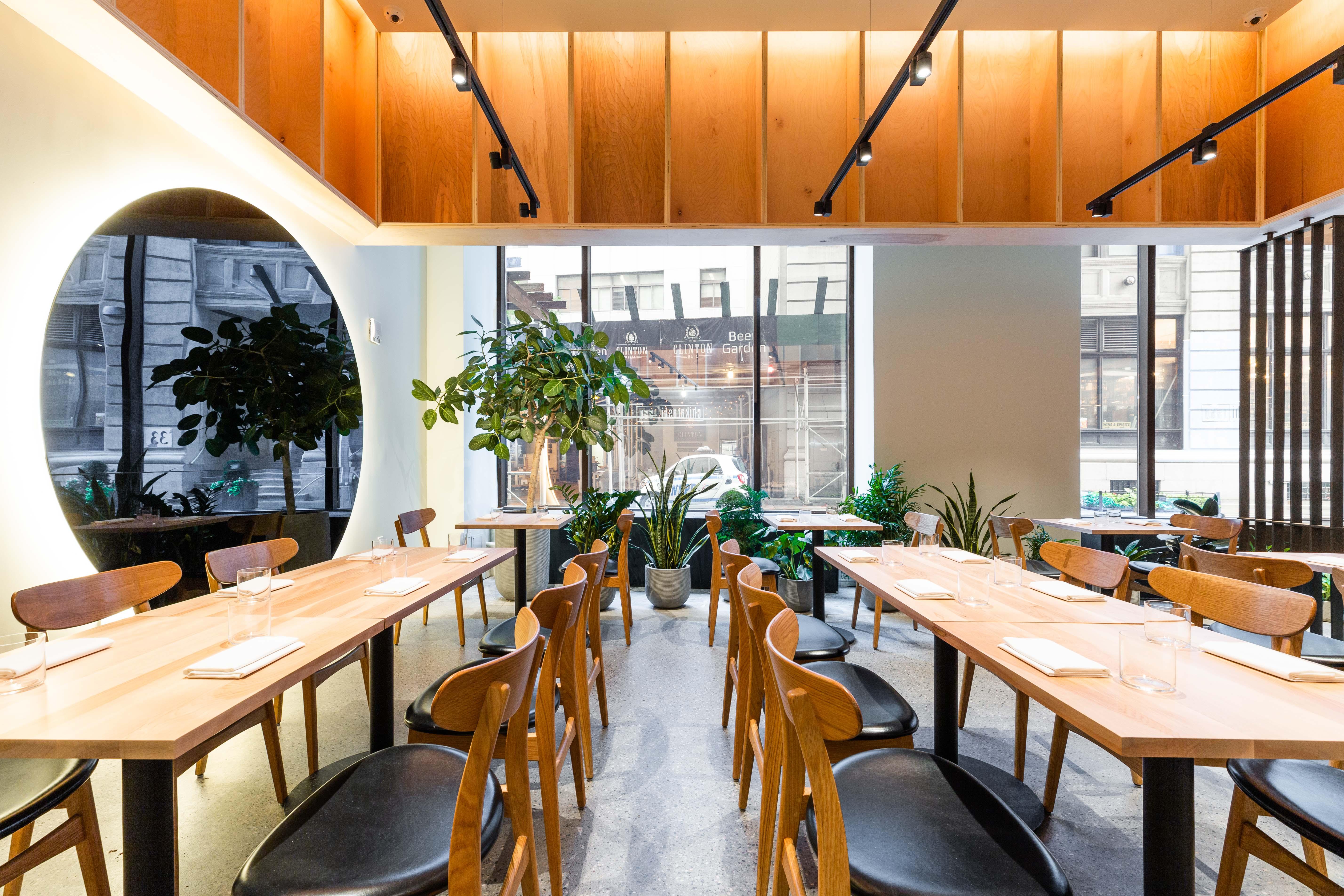 The golden-lit interior of a sleek restaurant space