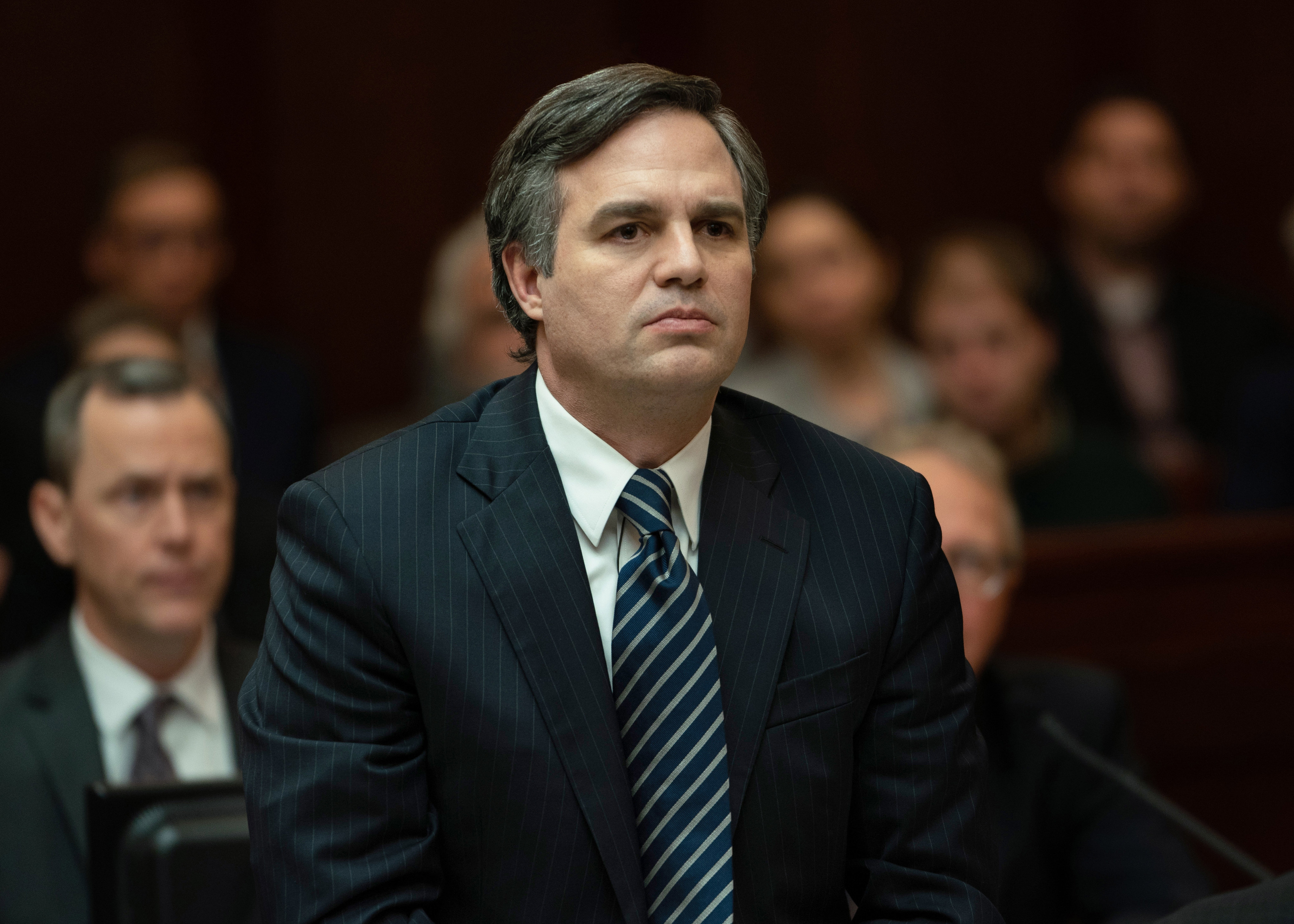 Mark Ruffalo playing a lawyer in a courtroom in the movie Dark Waters.