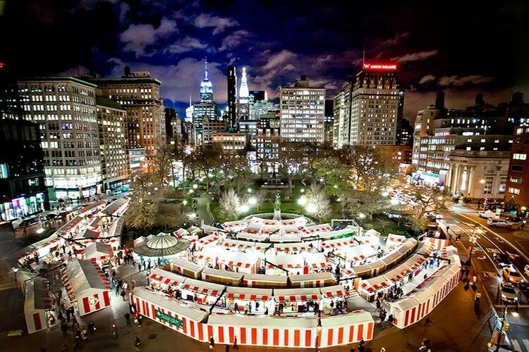 A bird's eye view of the union square holiday market at nighttime.
