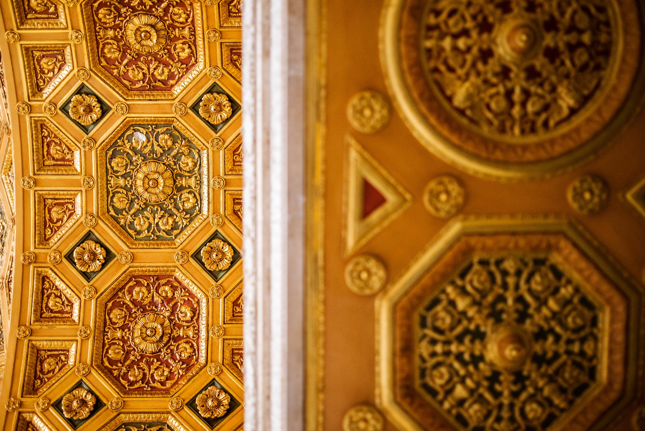 An ornate golden ceiling arch with detailed medallions.