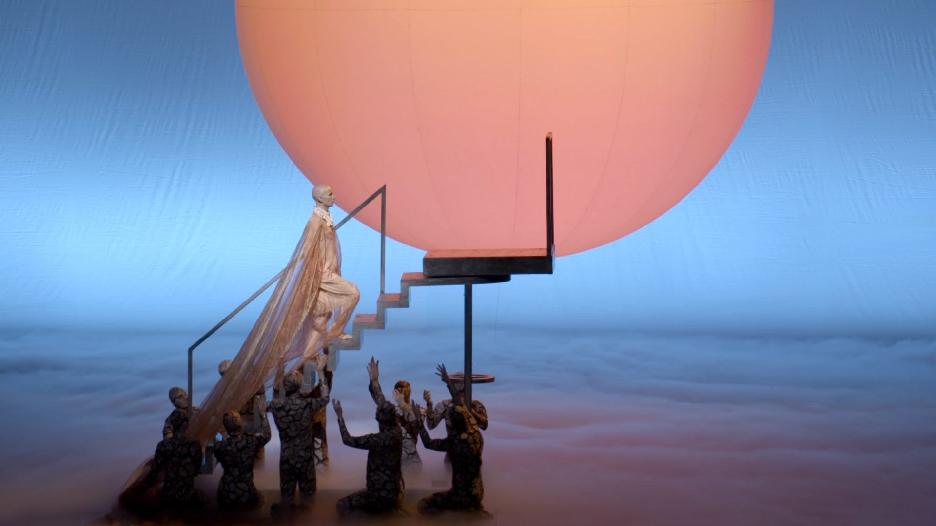 Akhnaten, played by Anthony Roth Costanzo, ascends steps to the sun, during a dress rehearsal for the opera.