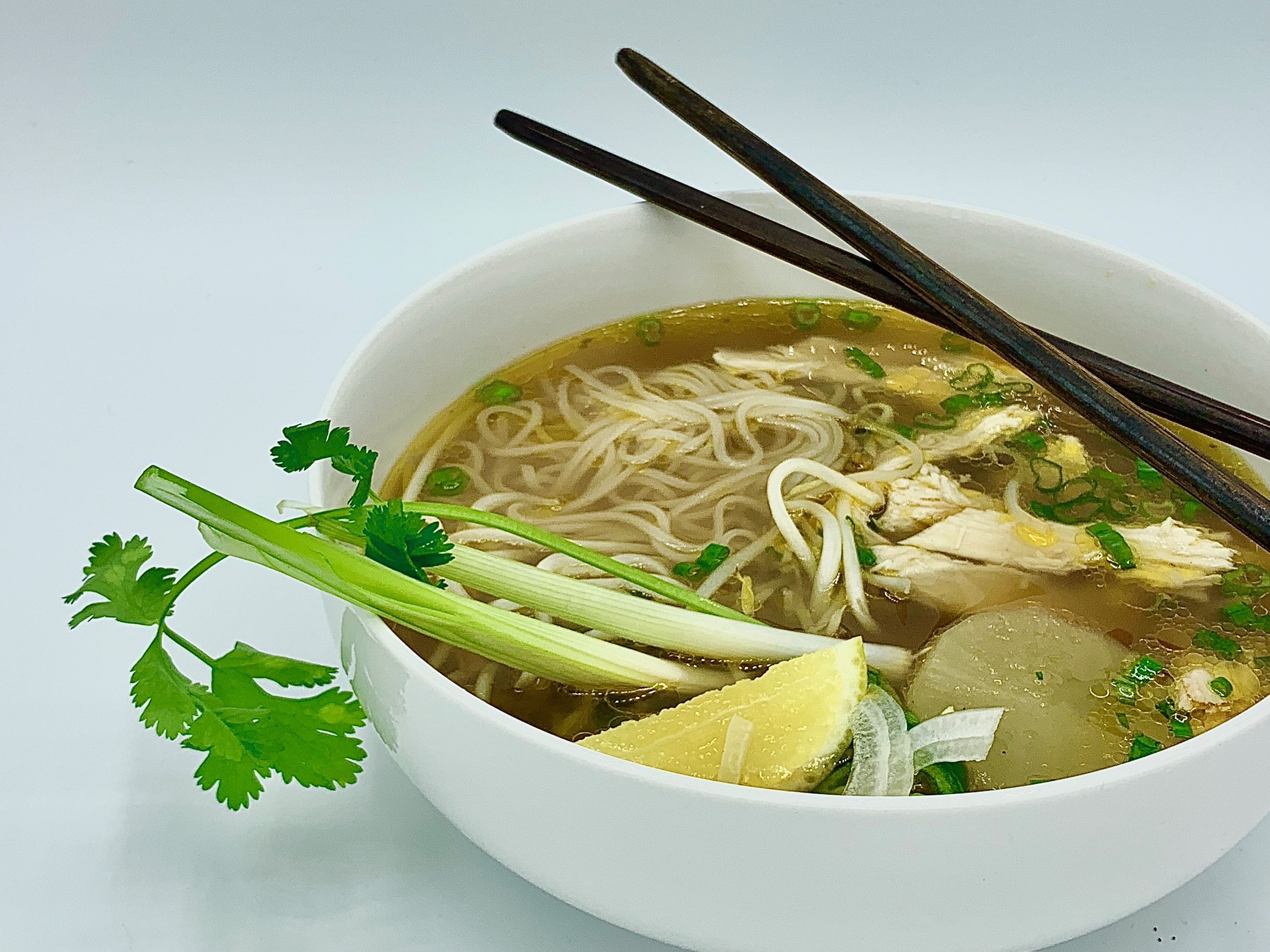 A bowl of chicken pho