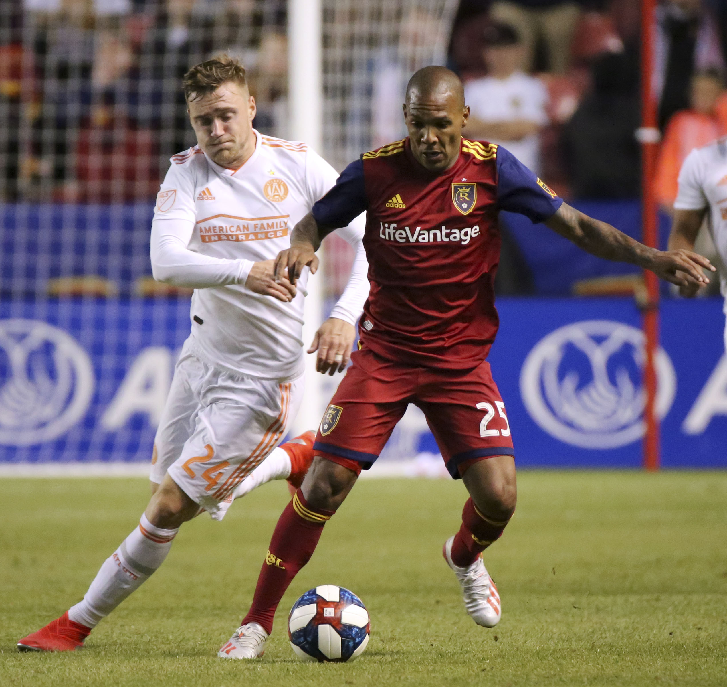 Atlanta United defender Julian Gressel (24) and Real Salt Lake midfielder Everton Luiz (25) fight for the ball during an MLS game at Rio Tinto Stadium in Sandy on Friday, May 24, 2019. Real Salt Lake won 2-1.