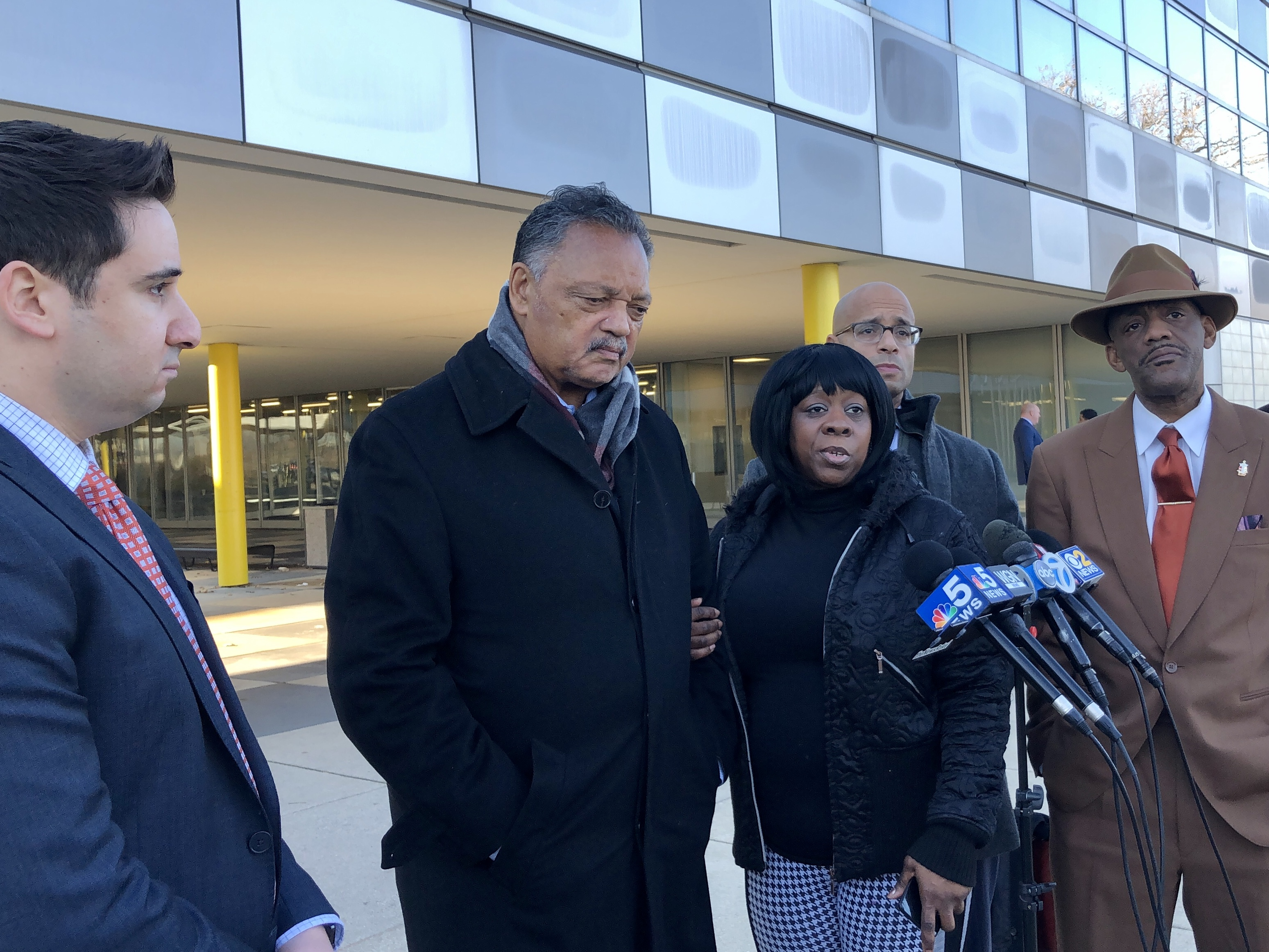 Keshia Johnson speaks to reporters after a Thursday court hearing for her son Bernard Kersh. Johnson was joined by her son's attorneys, Andrew M. Stroth and Sami Azhari, as well as the Rev. Jesse Jackson and community activist Eric Russell.