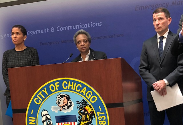 Mayor Lori Lightfoot answers questions about the FOP's demand for an 18% pay raise during a news conference Thursday on winter preparedness at the 911 center.